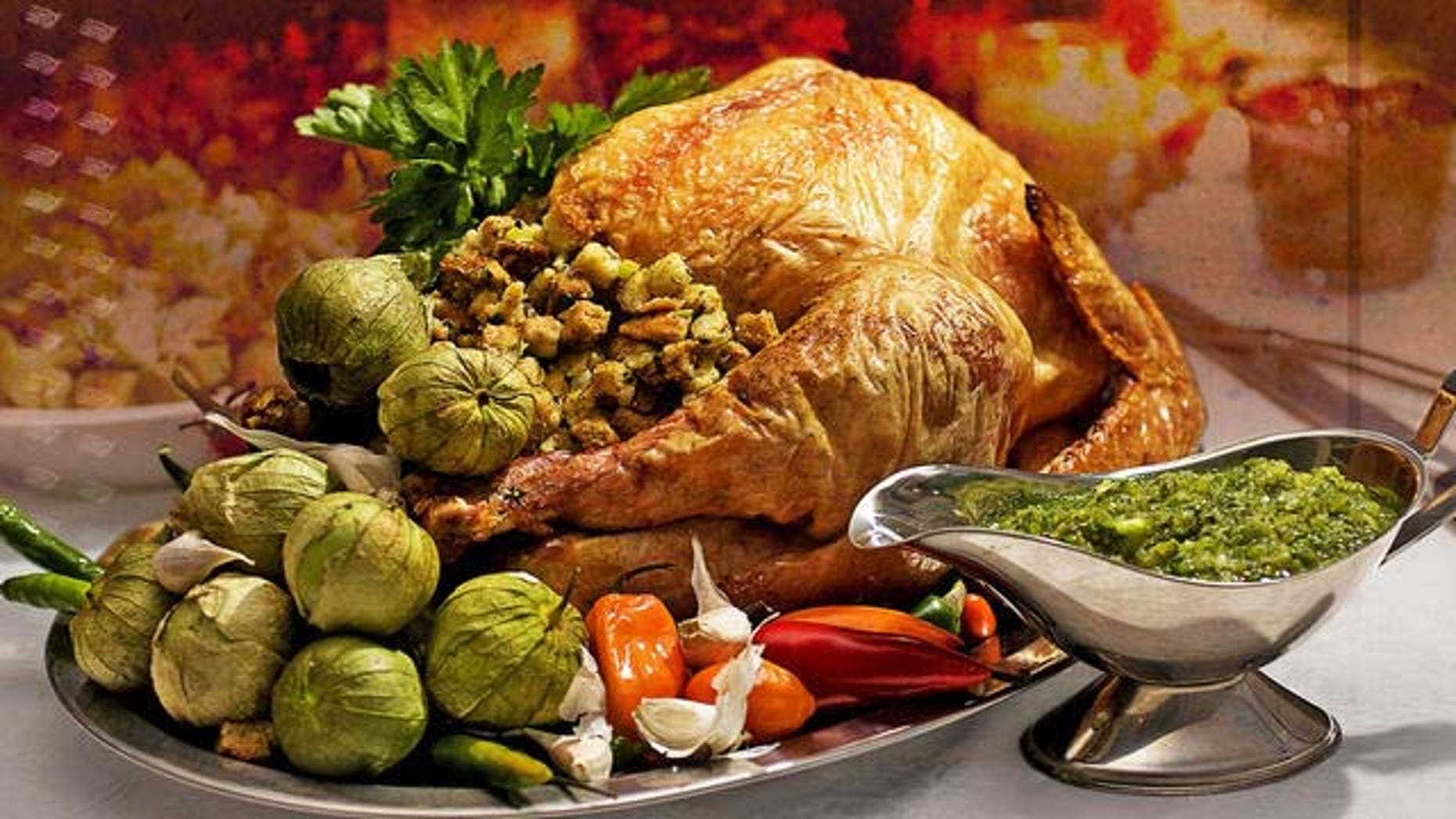 **FOR USE WITH AP LIFESTYLES** **FILE**   This Oct. 19, 2008 file photo shows a Grill-roasted Brined Turkey with Anaheim Chile Salsa Verde.  To save money this Thanksgiving brine your own bird.   (AP Photo/Larry Crowe, FILE)