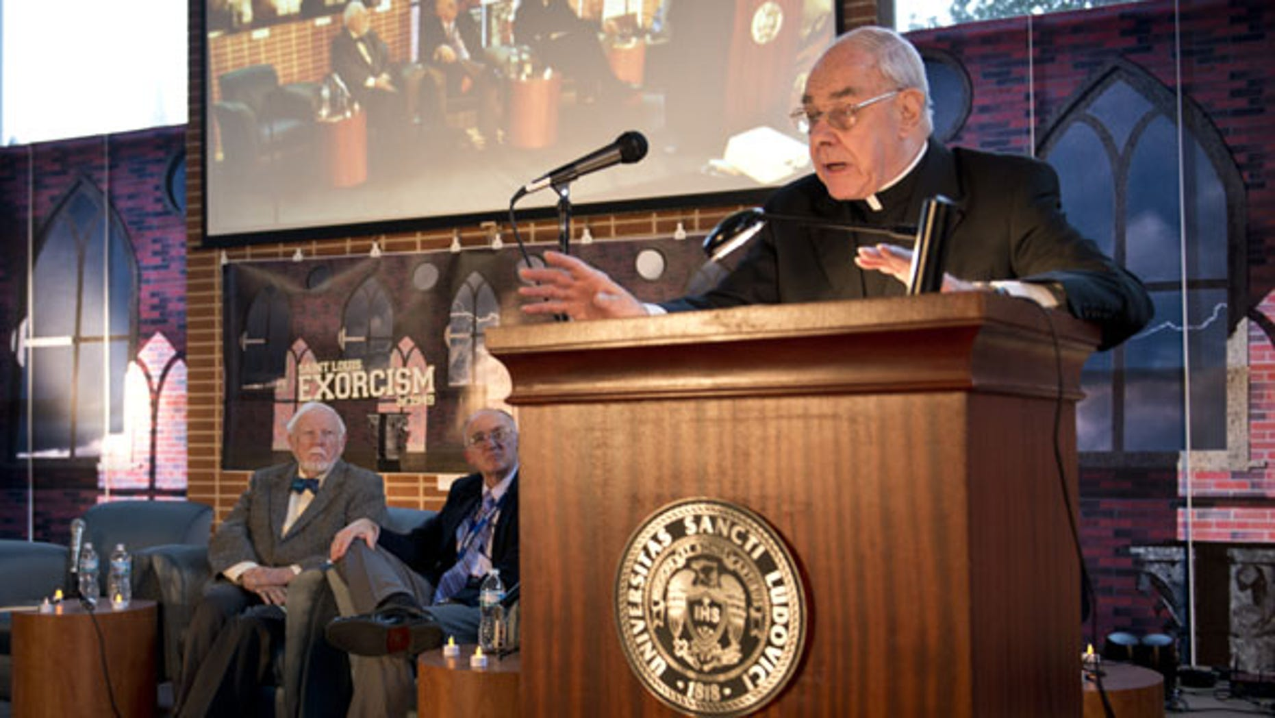 October 29, 2013: In this photo provided by St. Louis University, the Rev. John Padberg, S.J., director of the Institute of Jesuit Sources, speaks during a panel discussion at St. Louis University in St. Louis about the month-long 1949 demon-purging ritual at the school's former Alexian Brothers Hospital. (AP Photo)