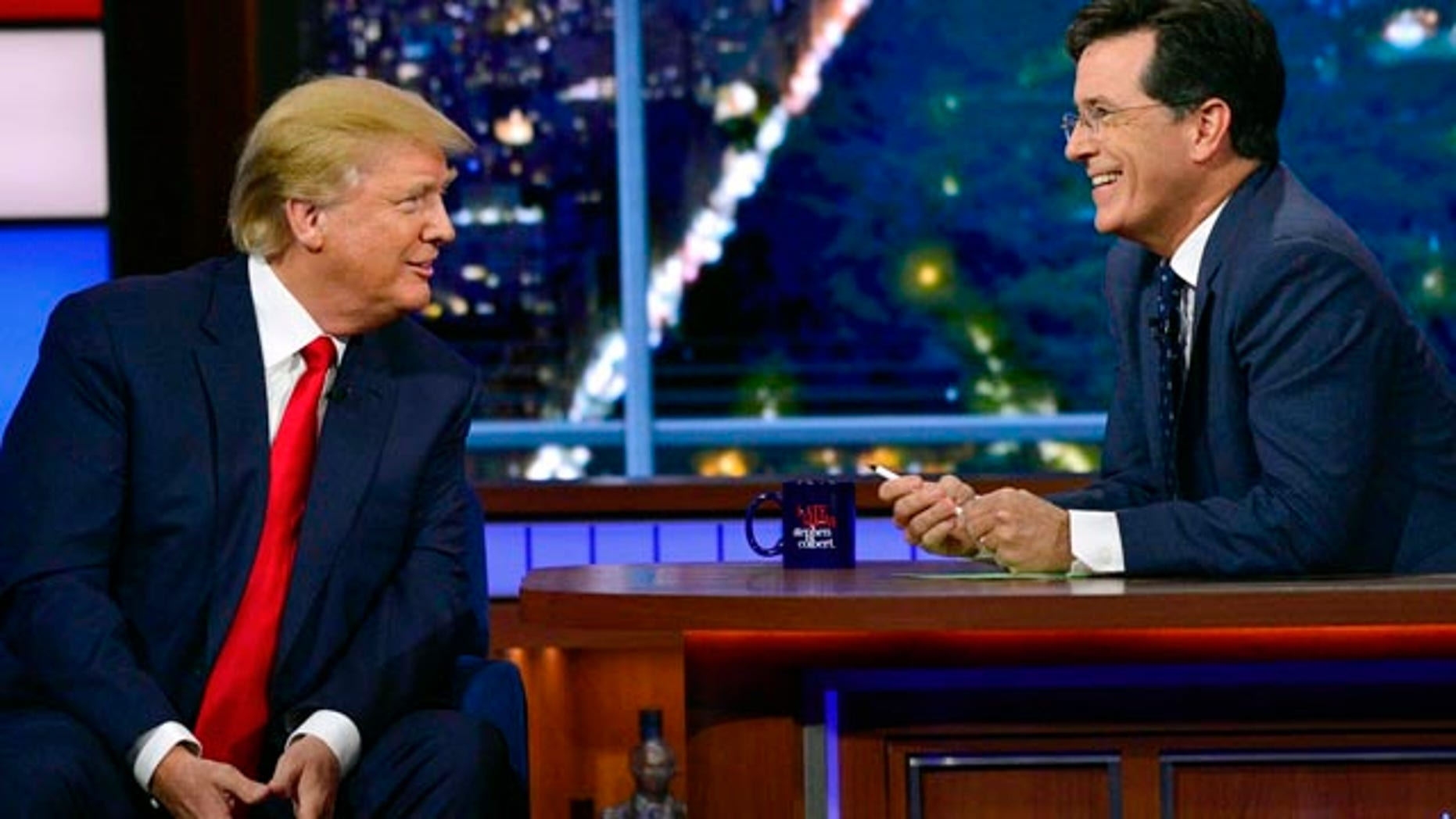 Sept. 22, 2015: In this photo provided by CBS, Republican presidential candidate Donald Trump, left, joins host Stephen Colbert on the set of 'The Late Show with Stephen Colbert' in New York. (John Paul Filo/CBS via AP)