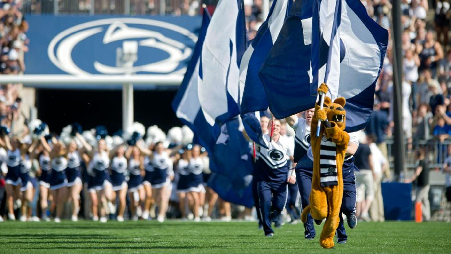 The Penn State Nittany Lion leads the cheerleaders and the football team onto the field for the Blue White game on Saturday, April 18, 2015, at Beaver Stadium in University Park, Pa. (Abby Drey/Centre Daily Times/TNS via Getty Images)