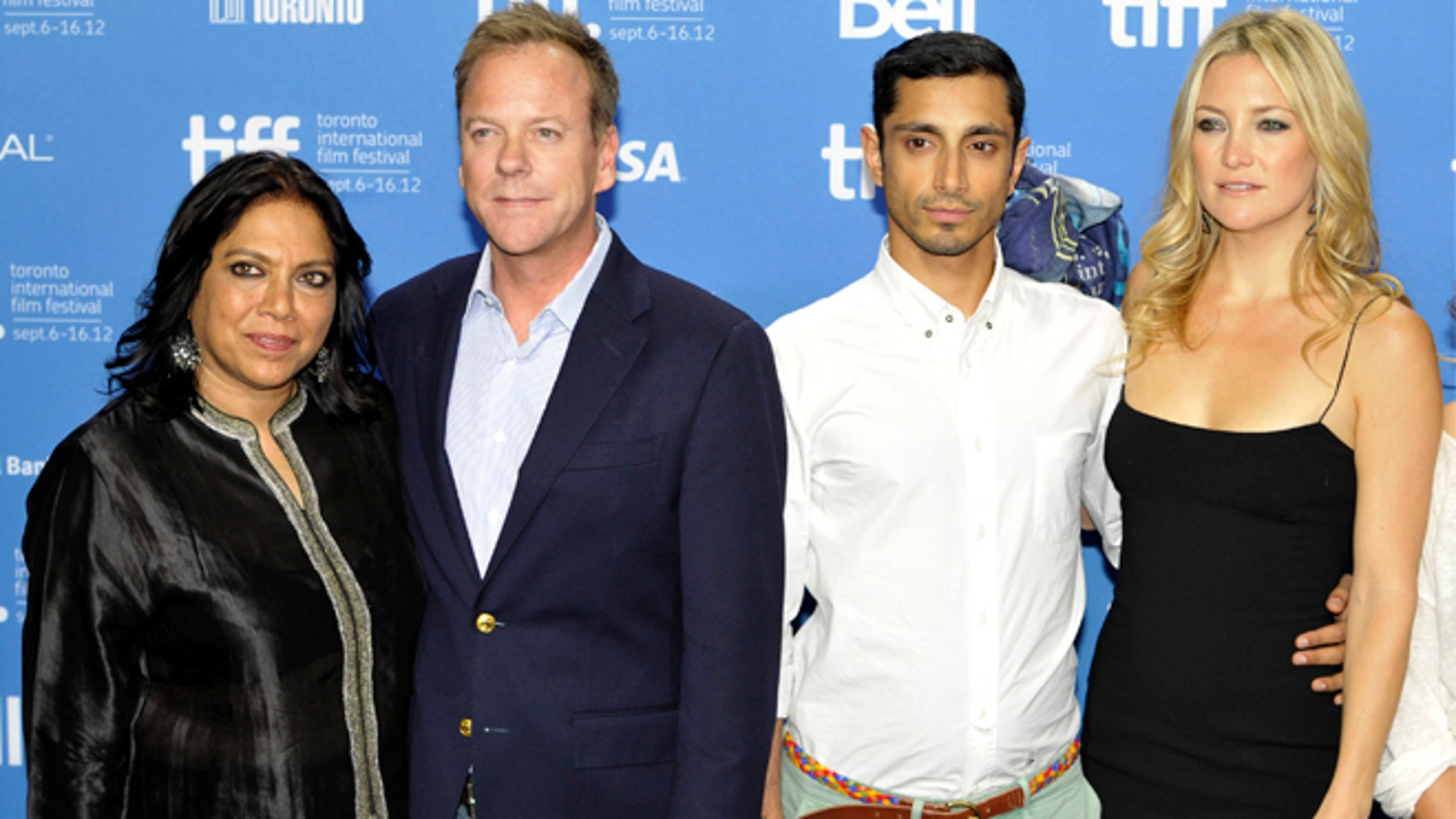 """Director Mira Nair, left, poses with cast members (from left) Kiefer Sutherland, Riz Ahmed and Kate Hudson at a news conference for their film """"The Reluctant Fundamentalist"""" at the 37th Toronto International Film Festival September 9, 2012."""