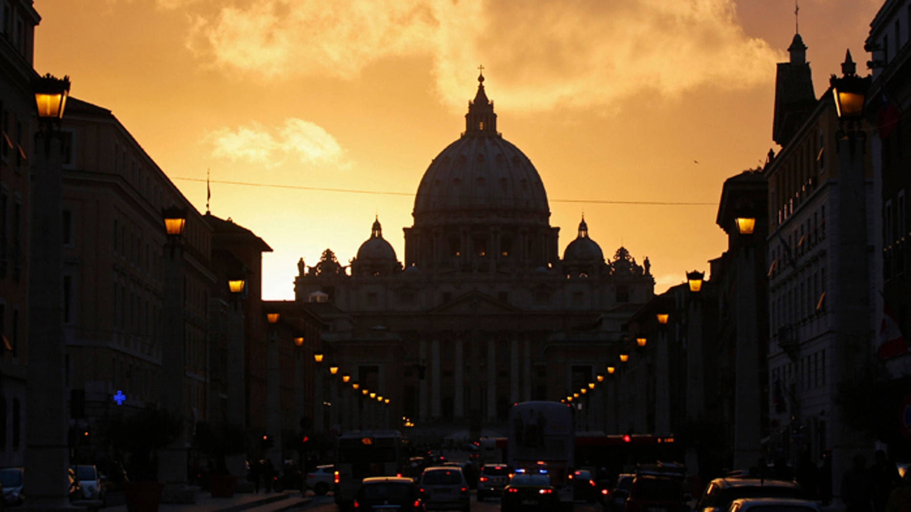 Saint Peter's Basilica at the Vatican is silhouetted during sunset in Rome. Roman Catholic Cardinals will begin their conclave inside the Vatican's Sistine Chapel Tuesday to elect a new pope.