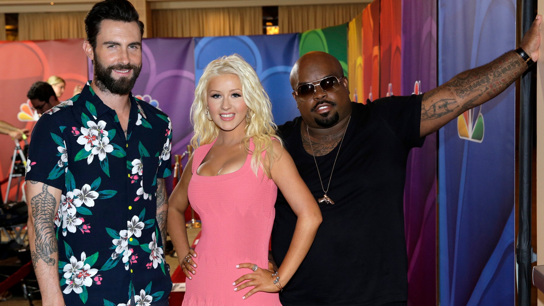 """This image released by NBC shows judges, from left, Adam Levine, Christina Aguilera, and CeeLo Green at """"The Voice"""" session during the NBCUniversal Press Tour in Beverly Hills, Calif., on Saturday, July 27, 2013. (AP Photo/NBC, Paul Drinkwater)"""