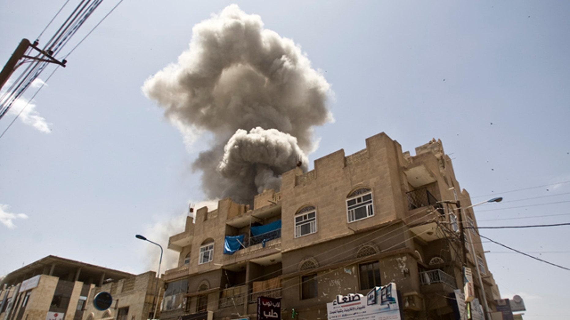 May 10, 2015: Smoke rises from a house of former Yemeni president Ali Abdullah Saleh after a Saudi-led airstrike in Sanaa, Yemen. (AP Photo/Hani Mohammed, File)