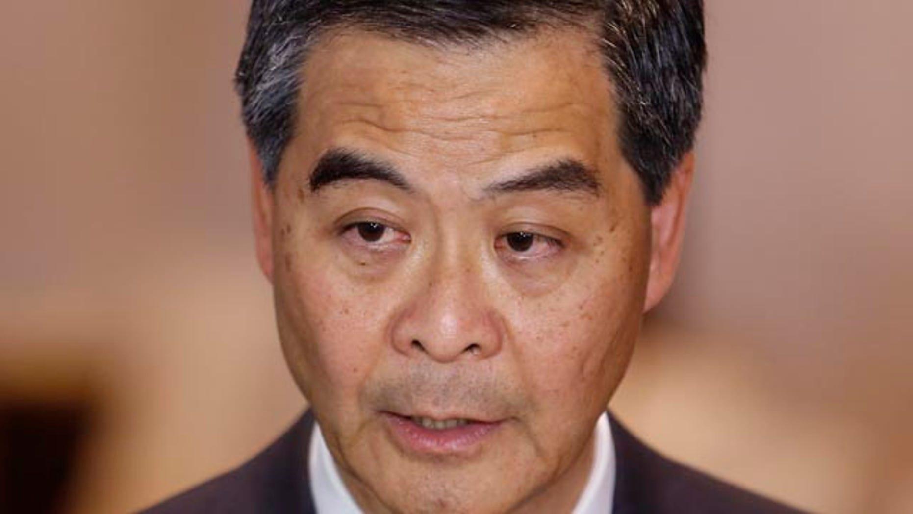 October 15, 2014: Hong Kong Chief Executive Leung Chun-ying speaks to the media after a presentation ceremony in Hong Kong. (AP Photo/Kin Cheung)