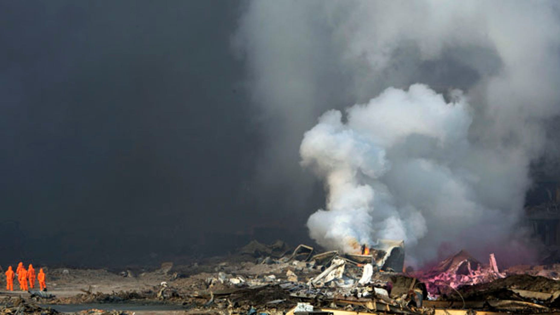 Aug. 13, 2015: Smoke continues to billow out after an explosion at a warehouse in China's Tianjin municipality.