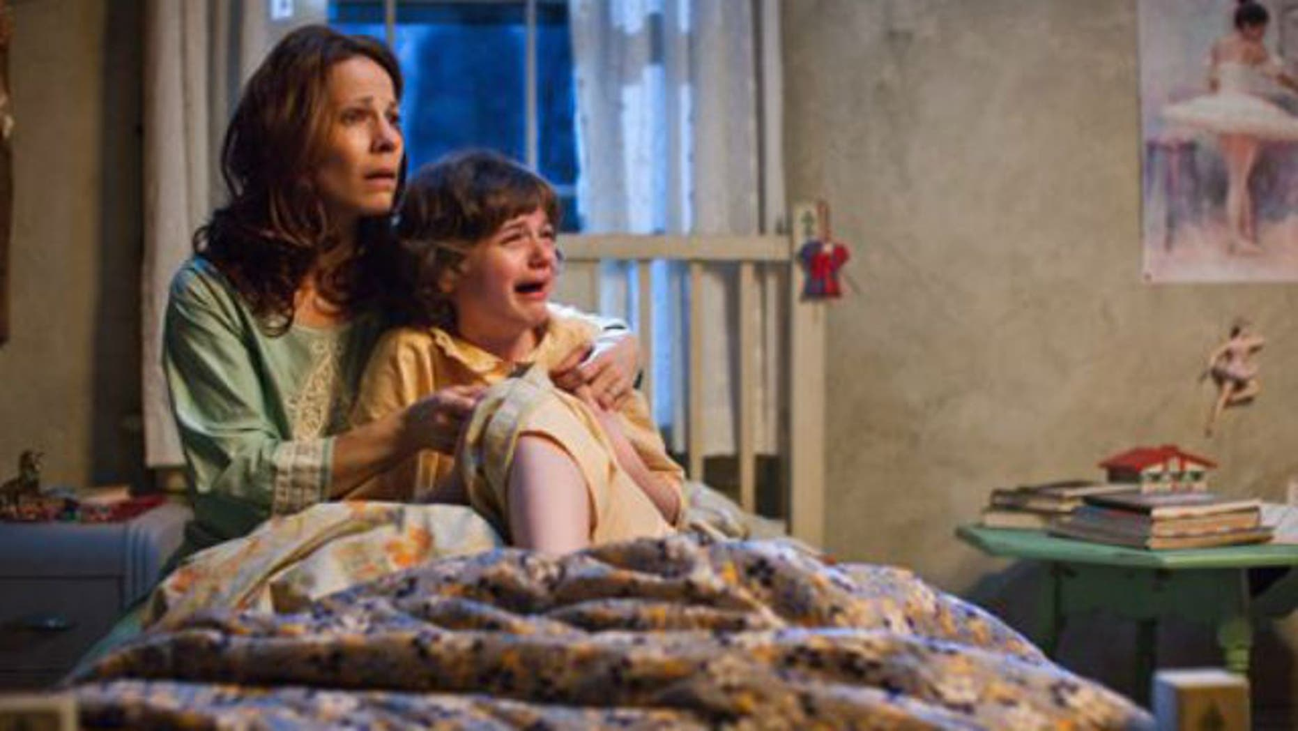 "Lili Taylor portrays Carolyn Perron, left, and Joey King portrays Christine in a scene from ""The Conjuring."""
