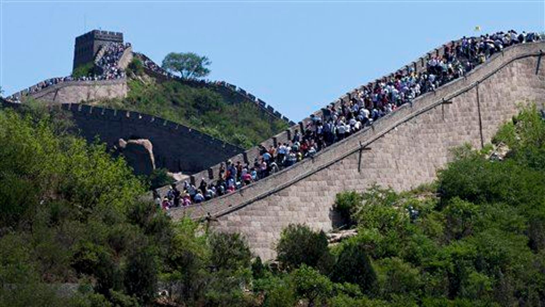 Tourists go sightseeing on the Great Wall of China during a weekend at Badaling, north of Beijing, June 2, 2012.