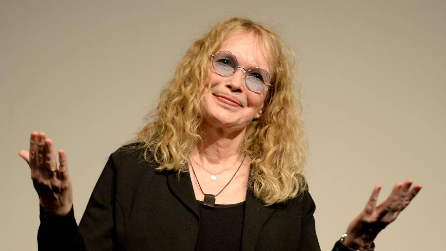 """FILE - In this Aug. 8, 2014 file photo, actress Mia Farrow gestures as she receives the """"Leopard Club Award"""" at the 67th Locarno International Film Festival in Locarno Switzerland. Farrow, 69, has returned to Broadway for the first time in 16 years to perform in A.R. Gurney's play """"Love Letters,"""" in which would-be lovers read aloud letters exchanged over a lifetime. (AP Photo/Keystone, Urs Flueeler, File)"""