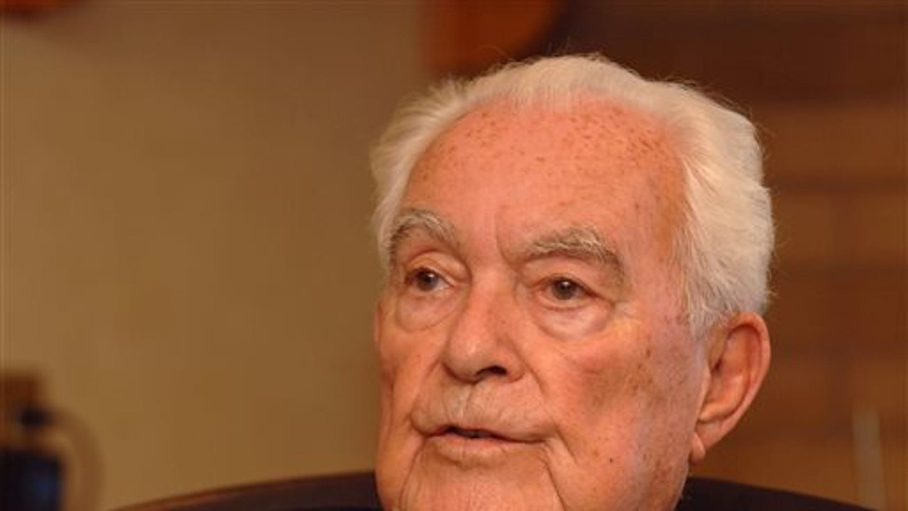 In this 2007 file photo, the Rev. Theodore Hesburgh, C.S.C, president emeritus of the University of Notre Dame, talks about his experiences over 90 years of life at his desk in the Hesburgh Library on the campus of the University of Notre Dame in South Bend, Ind.