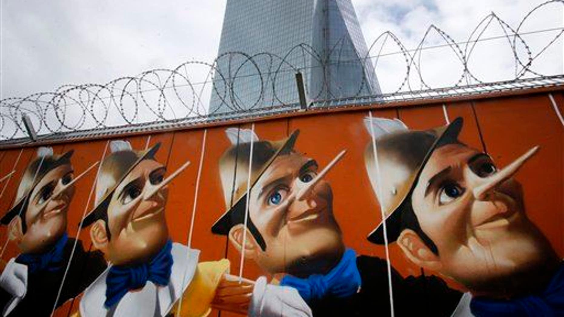 Graffiti is painted on a fence around the construction site of the new HQ of the European Central Bank. The graffiti was created by German street artist Case, who painted 16 Pinocchios.