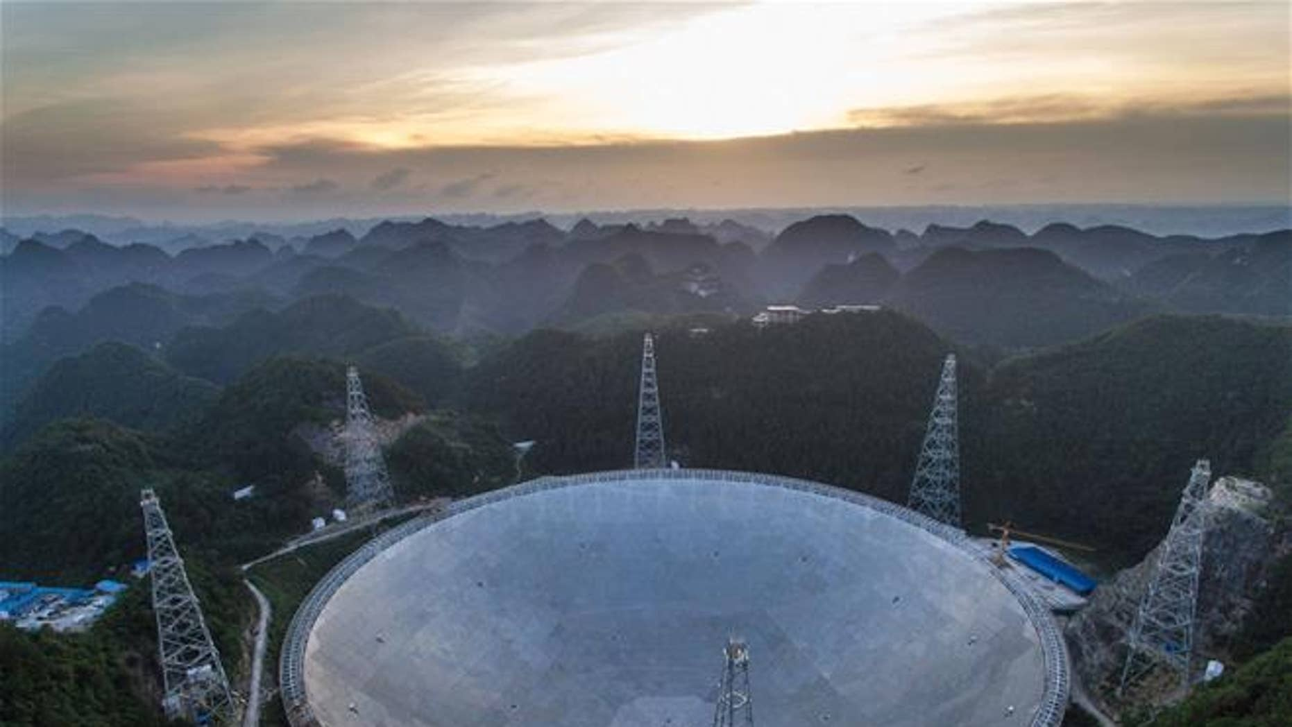 The sun sets above the Five-hundred-meter Aperture Spherical Telescope (FAST) in Pingtang County in southwestern China's Guizhou province.
