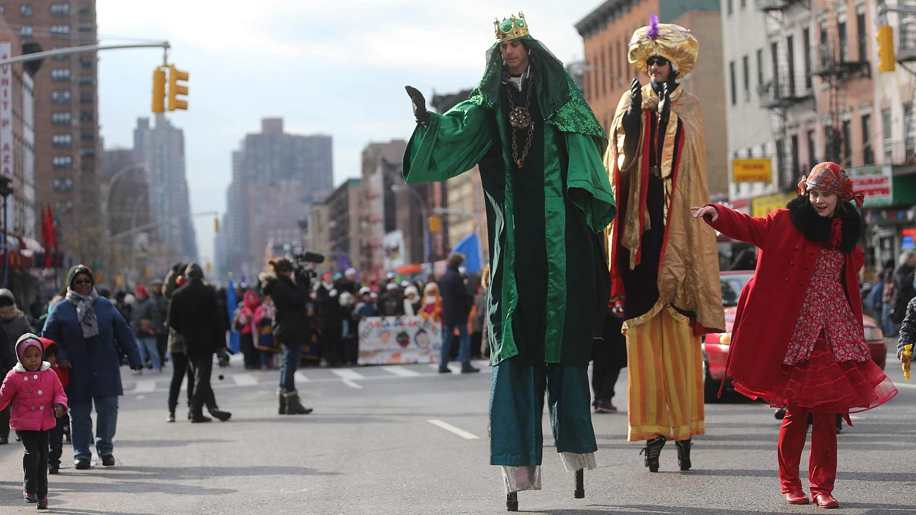 Revelers march during the Three Kings Day Parade in East Harlem on January 4, 2013 in New York City.