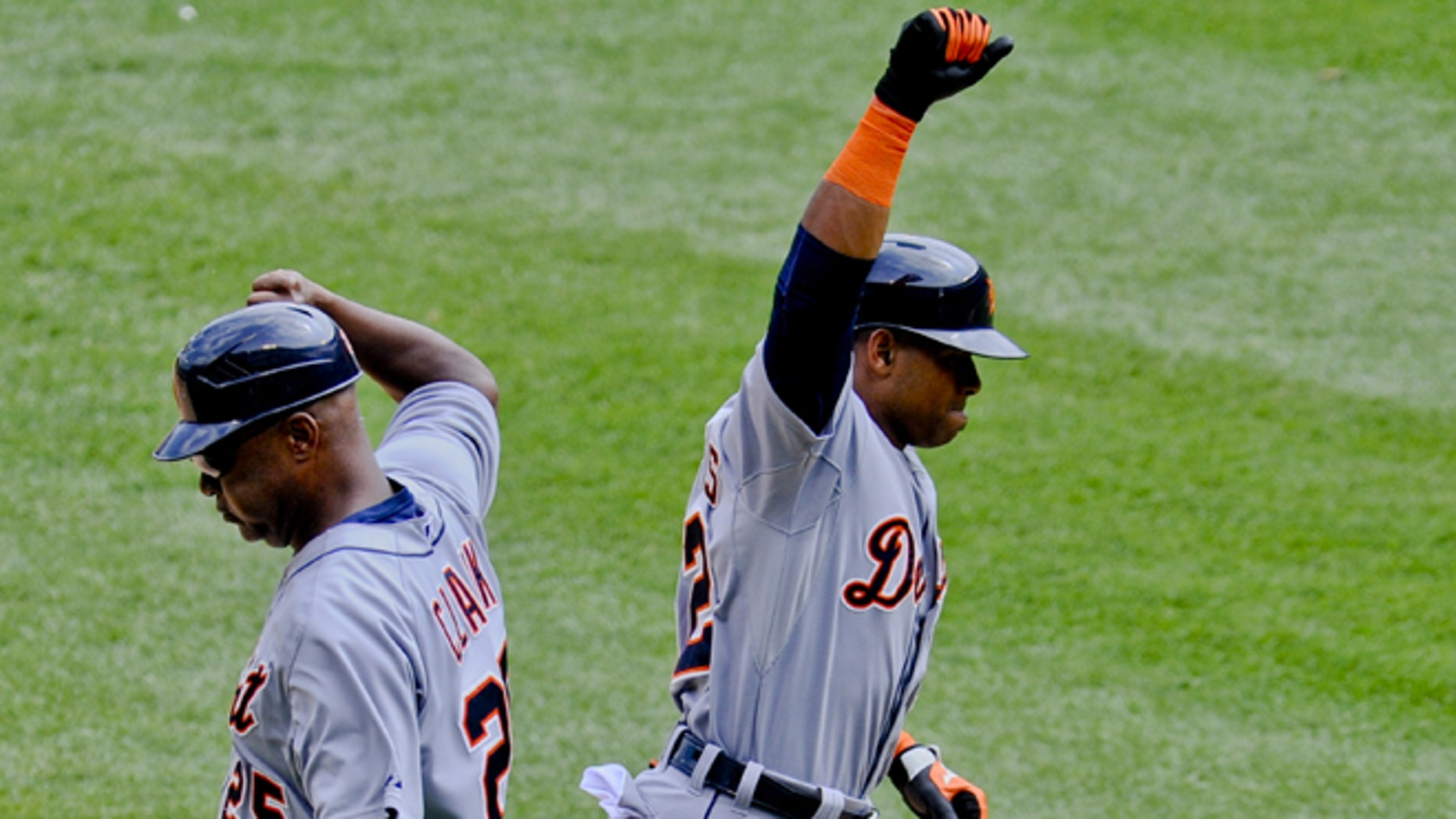 Detroit Tigers Yoenis Cespedes high-fives with coach Dave Clark in Chicago on Sunday, June 7,  2015.
