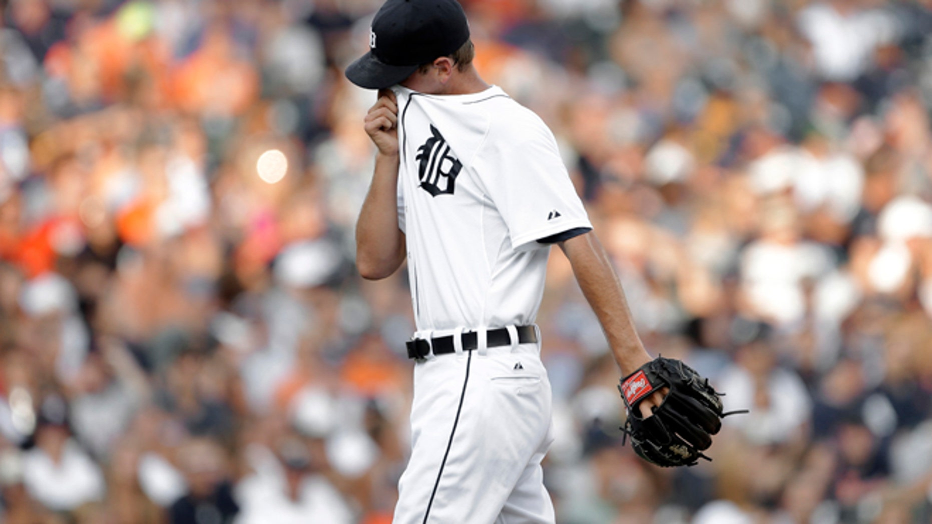 July 17: Tigers' Jacob Turner reacts after giving up a solo home run to Los Angeles Angels' Albert Pujols. The Detroit Tigers game against the Los Angeles Angles went on as planned, despite bomb threat.