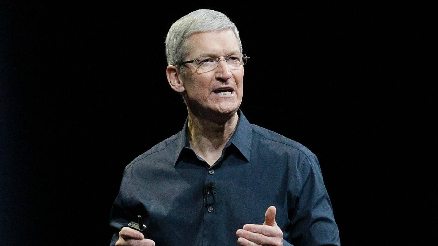 """FILE - In this June 2, 2014, file photo, Apple CEO Tim Cook speaks at the Apple Worldwide Developers Conference event in San Francisco. Cook says that so-called """"religious objection"""" legislation being introduced in a number states like Indiana and Texas is dangerous. In an op-ed piece for The Washington Post, Cook said that the bills under consideration """"have the potential to undo decades of progress toward greater equality."""" (AP Photo/Jeff Chiu, File)"""