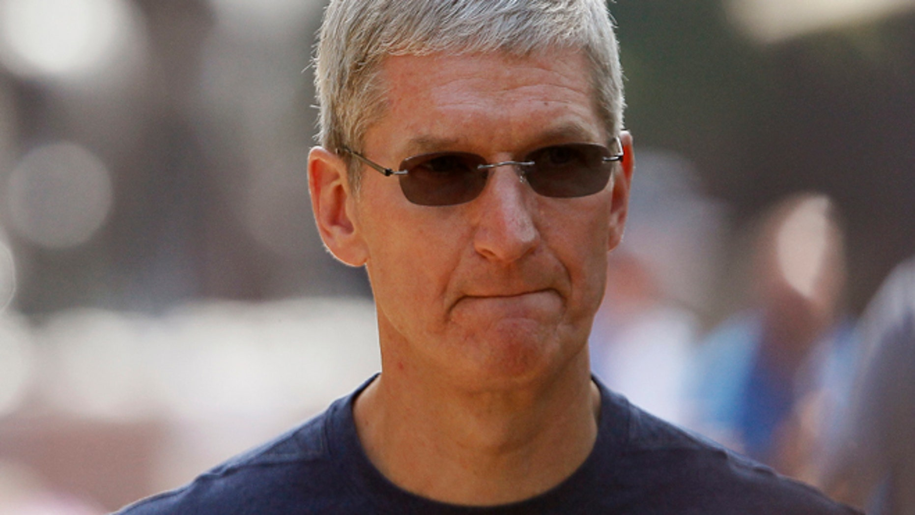 July 9: Apple Inc. CEO Tim Cook walks down a sidewalk during a break on the first day of the Allen and Co. media conference in Sun Valley.