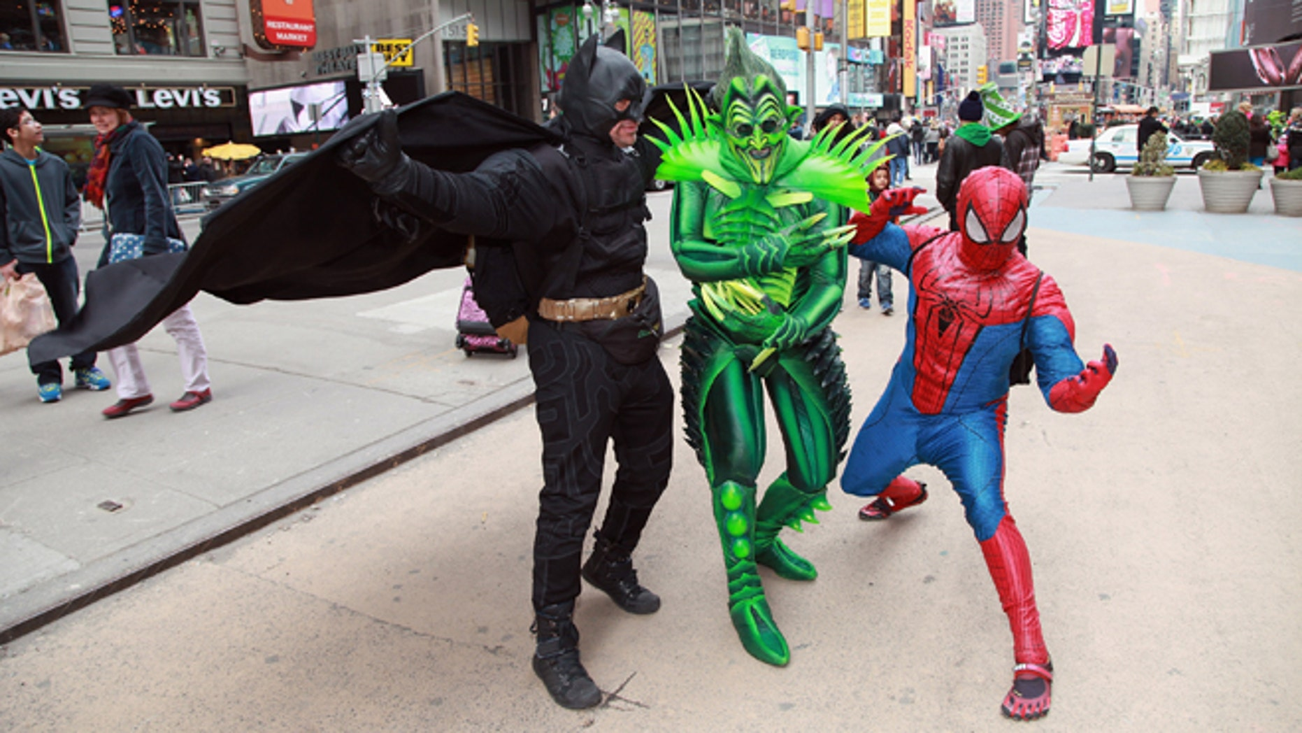 """NEW YORK, NY - MARCH 17:  The Green Goblin (Actor Bob Cuccioli) takes a stroll through Times Square for the """"Spider-Man: Turn off The Dark"""" St. Patrick's Day Celebration on March 17, 2013 in New York City.  (Photo by Taylor Hill/Getty Images)"""
