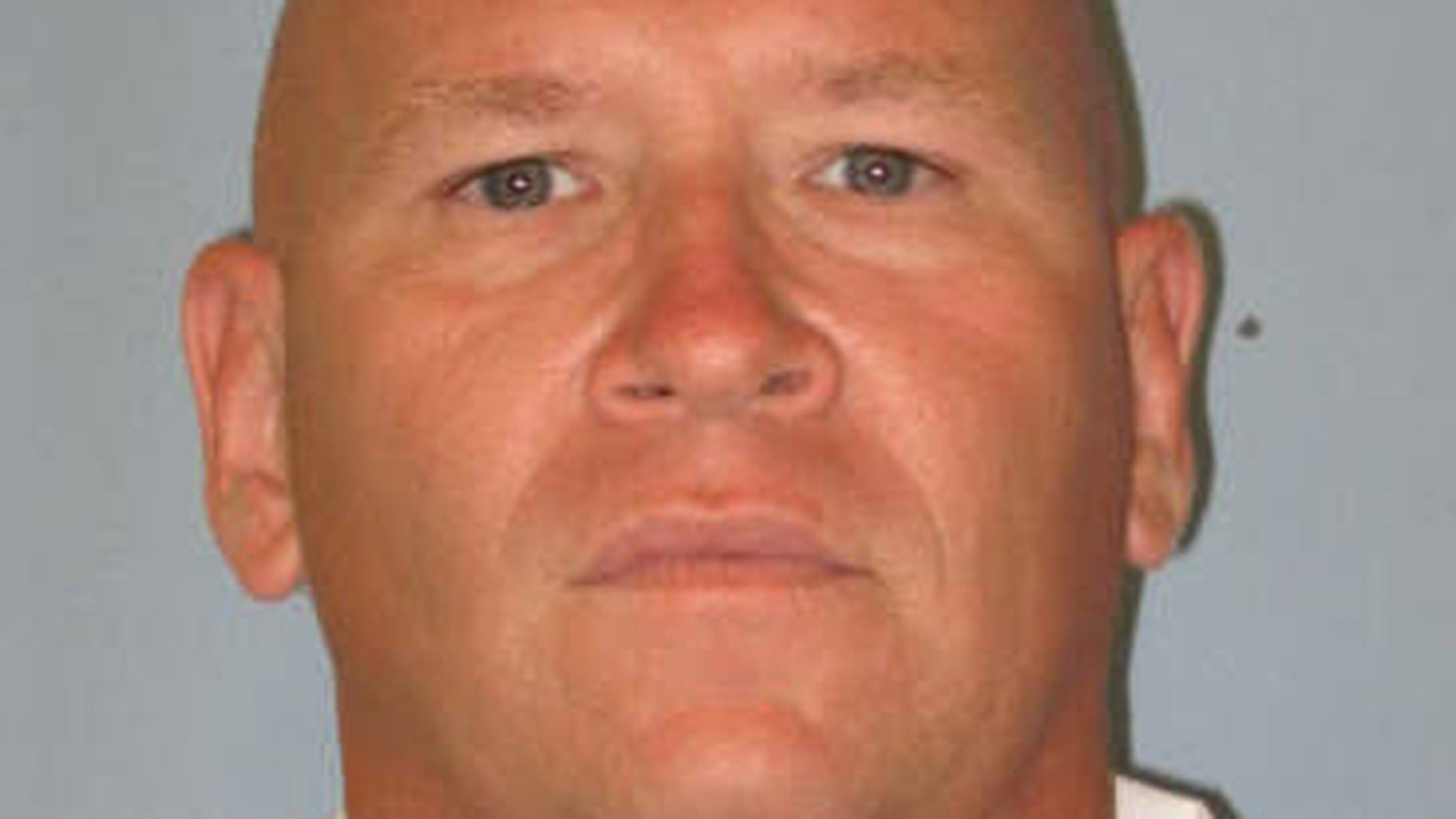 This photo, provided by the Alabama Department of Corrections, shows 42-year-old Timothy Richards.