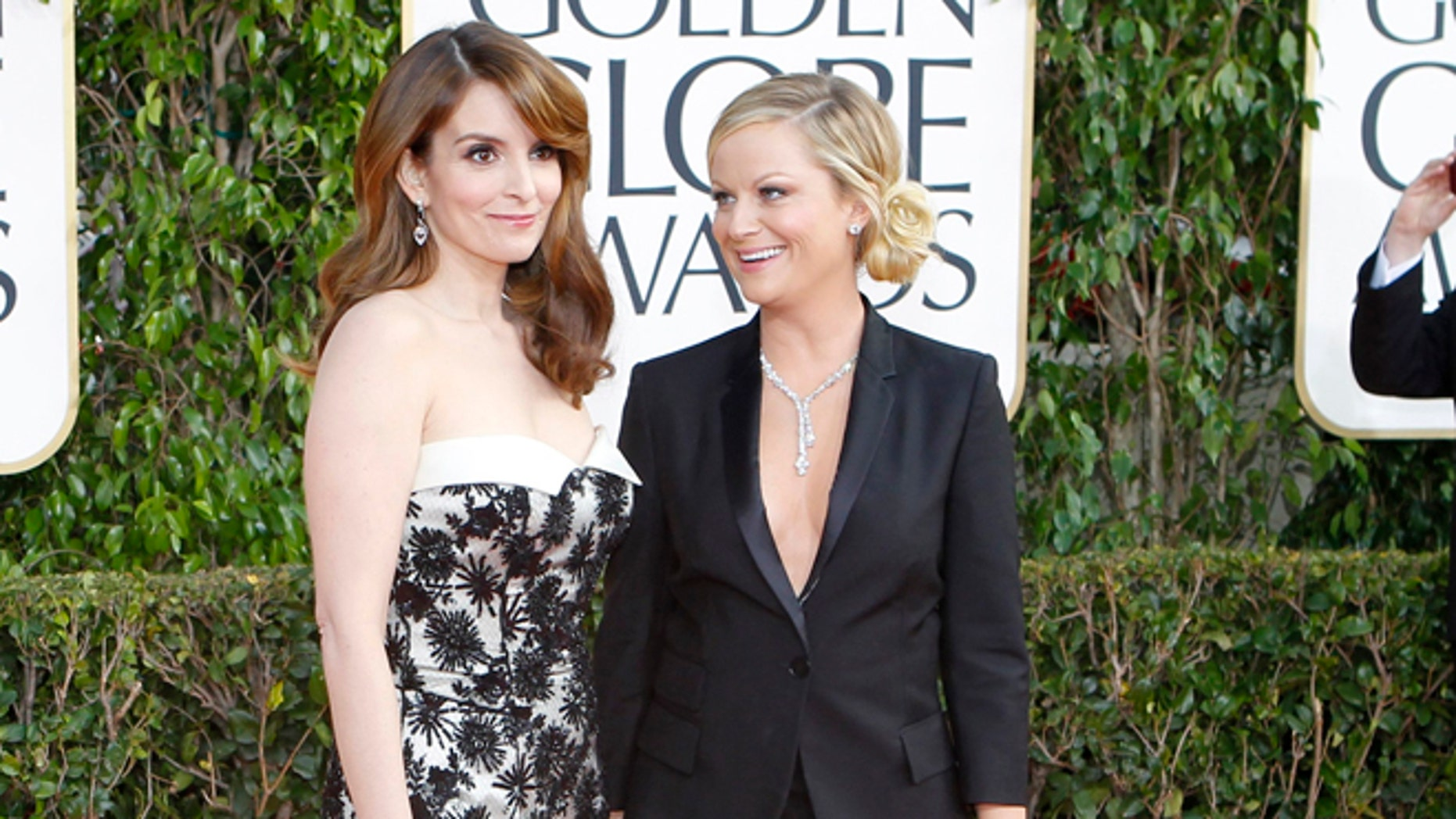 Golden Globe co-hosts, actresses Tina Fey (L) and Amy Poehler, arrive at the 70th annual Golden Globe Awards in Beverly Hills, California, January 13, 2013.