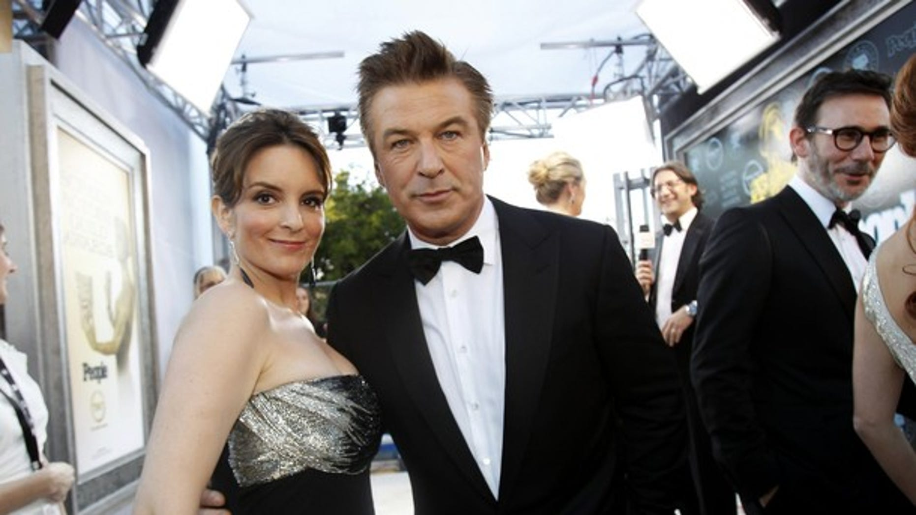 """Actors Tina Fey (L) and Alec Baldwin, from the television series """"30 Rock"""" at the Screen Actor's Guild Awards in January. The show will come to an end after its seventh season."""