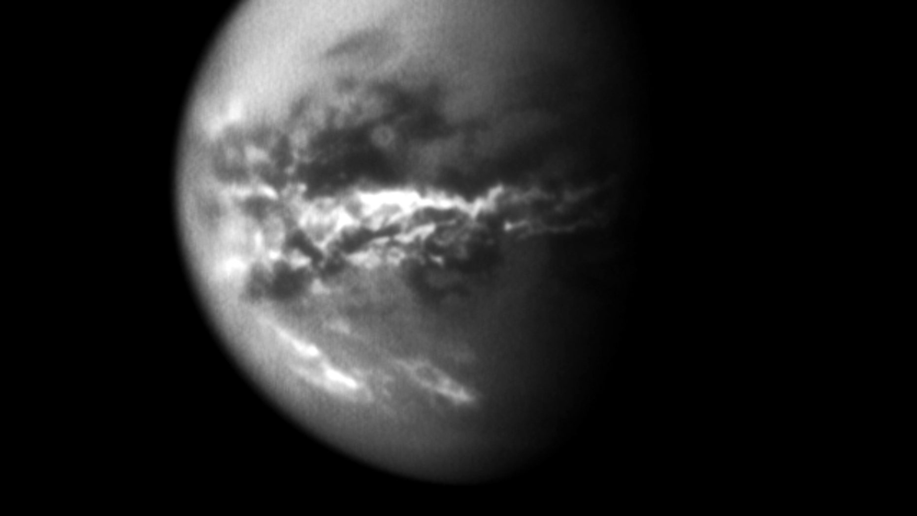NASAs Cassini spacecraft chronicled the change of seasons as it captured clouds concentrated near the equator of Saturns largest moon, Titan, on Oct. 18, 2010.