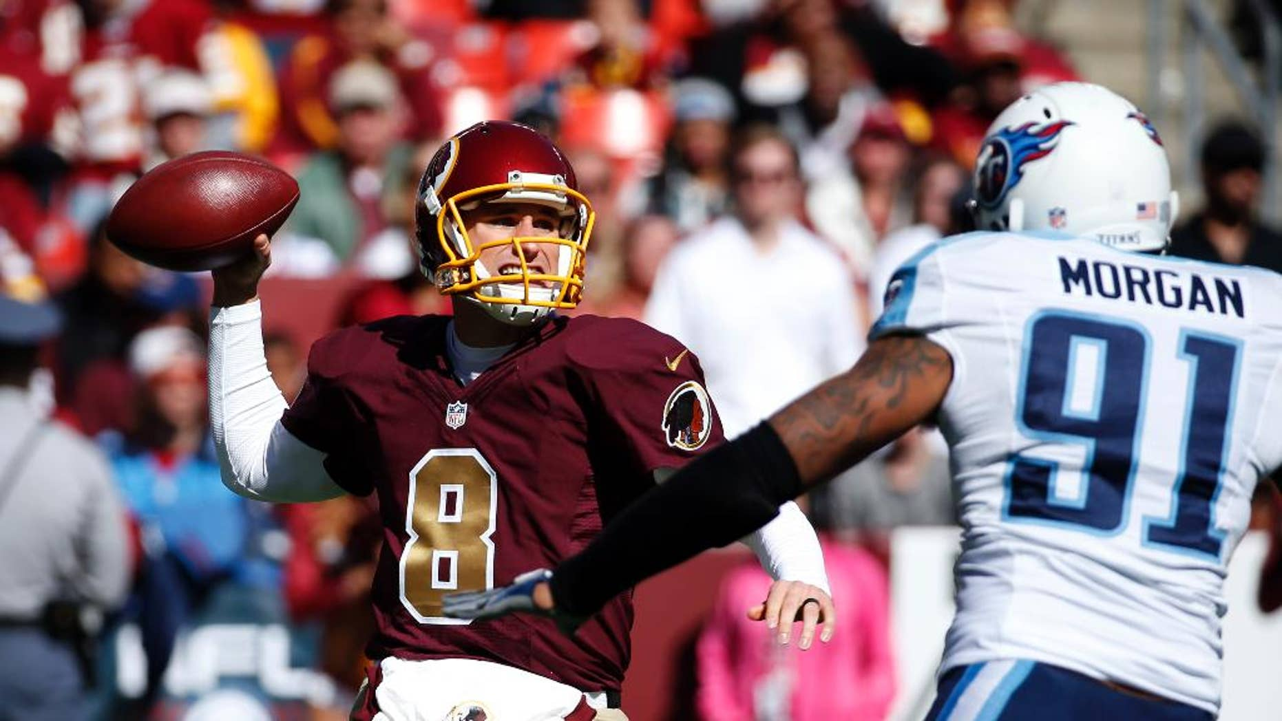 Washington Redskins quarterback Kirk Cousins (8) throws under pressure from Tennessee Titans outside linebacker Derrick Morgan (91) during the first half of an NFL football game, Sunday, Oct. 19, 2014, in Landover, Md. (AP Photo/Alex Brandon)