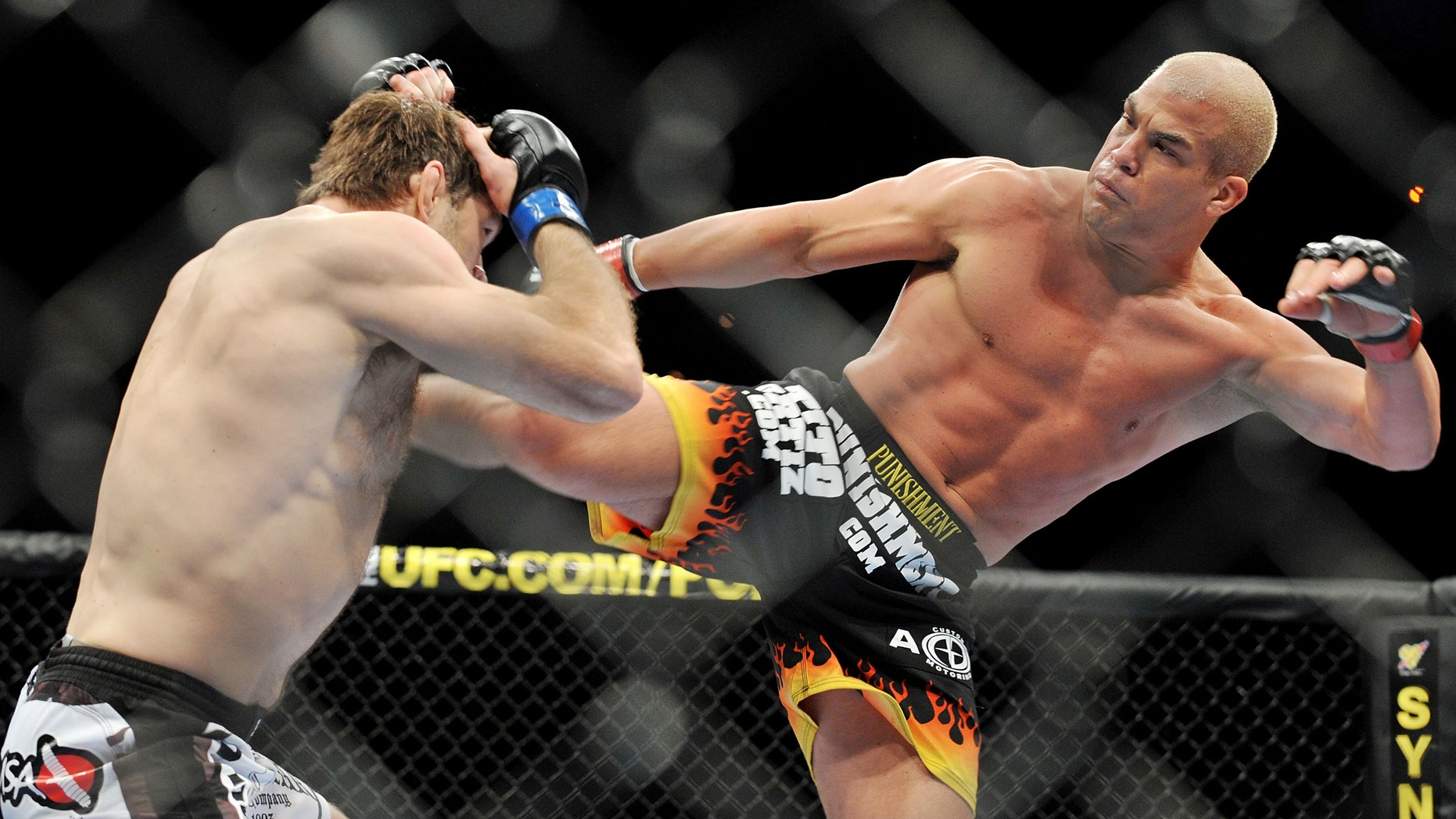 Tito Ortiz (R) battles Forrest Griffin during their Light Heavyweight Fight at the UFC 106 in 2009 in Las Vegas, Nevada.