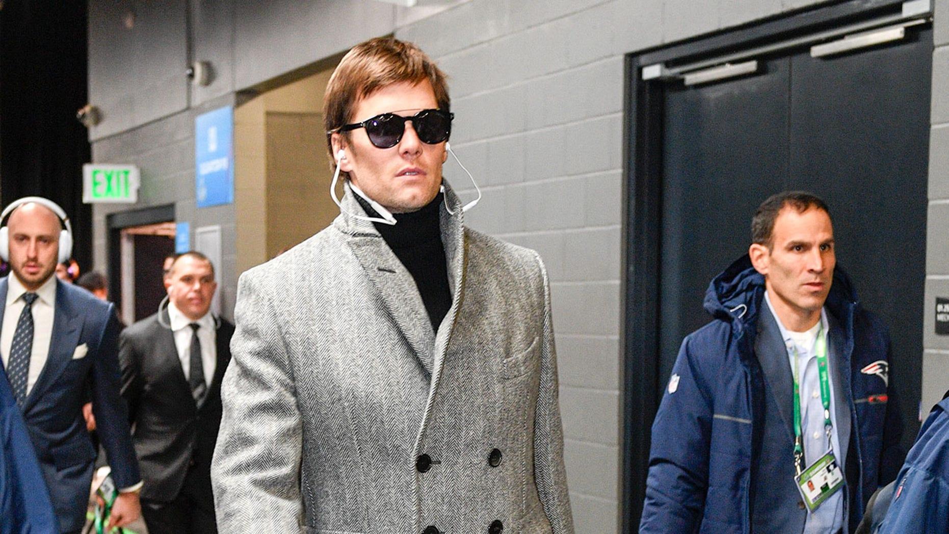 262eef6c6fb64 Tom Brady s Super Bowl coat has Twitter likening him to  Inspector ...