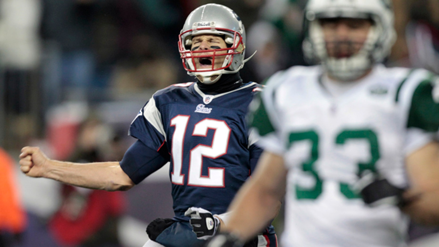 Dec. 6: Patriots QB Tom Brady celebrates after an Aaron Hernandez touchdown in the second half of the Patriots' rout of the New York Jets.
