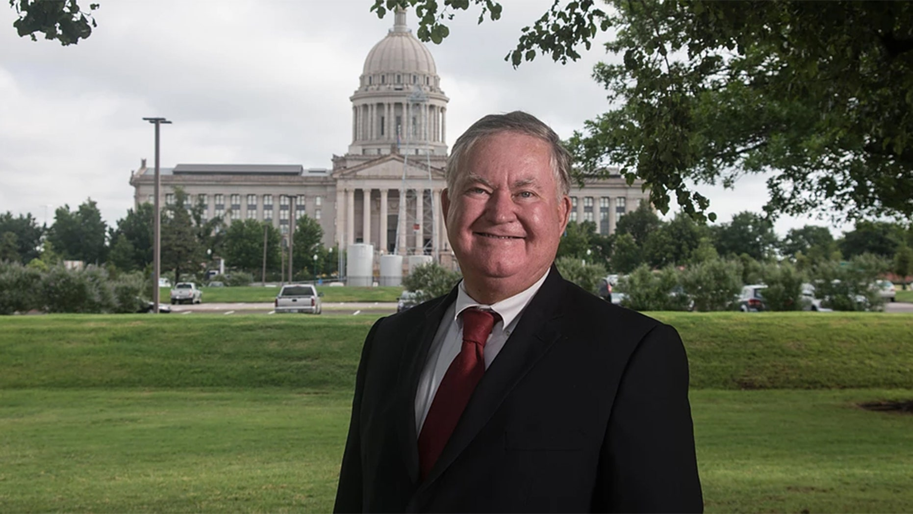 Democrat congressional candidate Tom Guild apologized after he was caught stealing his opponent's yard signs from alongside an Oklahoma road.
