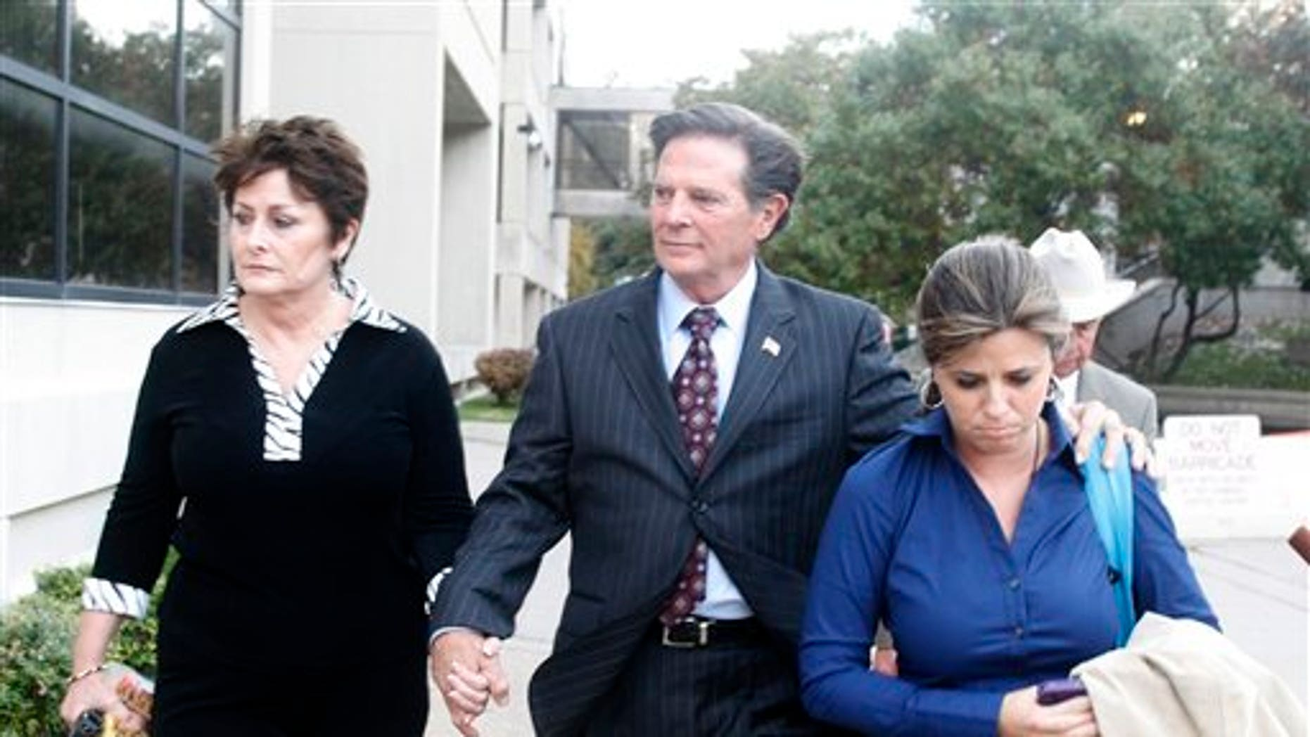 Former House Majority Leader Tom DeLay, along with his wife Christine and daughter Danielle Garcia, leave the Travis Coumty Courthouse in Austin, Texas on Wednesday, Nov. 24, 2010. A jury found Delay guilty of money laundering and conspiracy to commit money laundering. (AP Photo/Jack Plunkett)