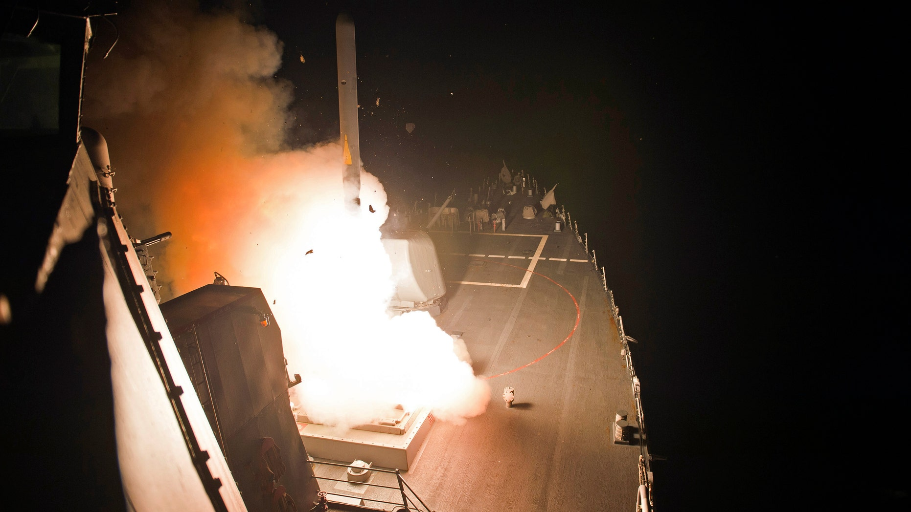 In this photo released by the U.S. Navy, the guided-missile destroyer USS Arleigh Burke launches Tomahawk cruise missiles, in the Arabian Gulf, Tuesday, Sept. 23, 2014.