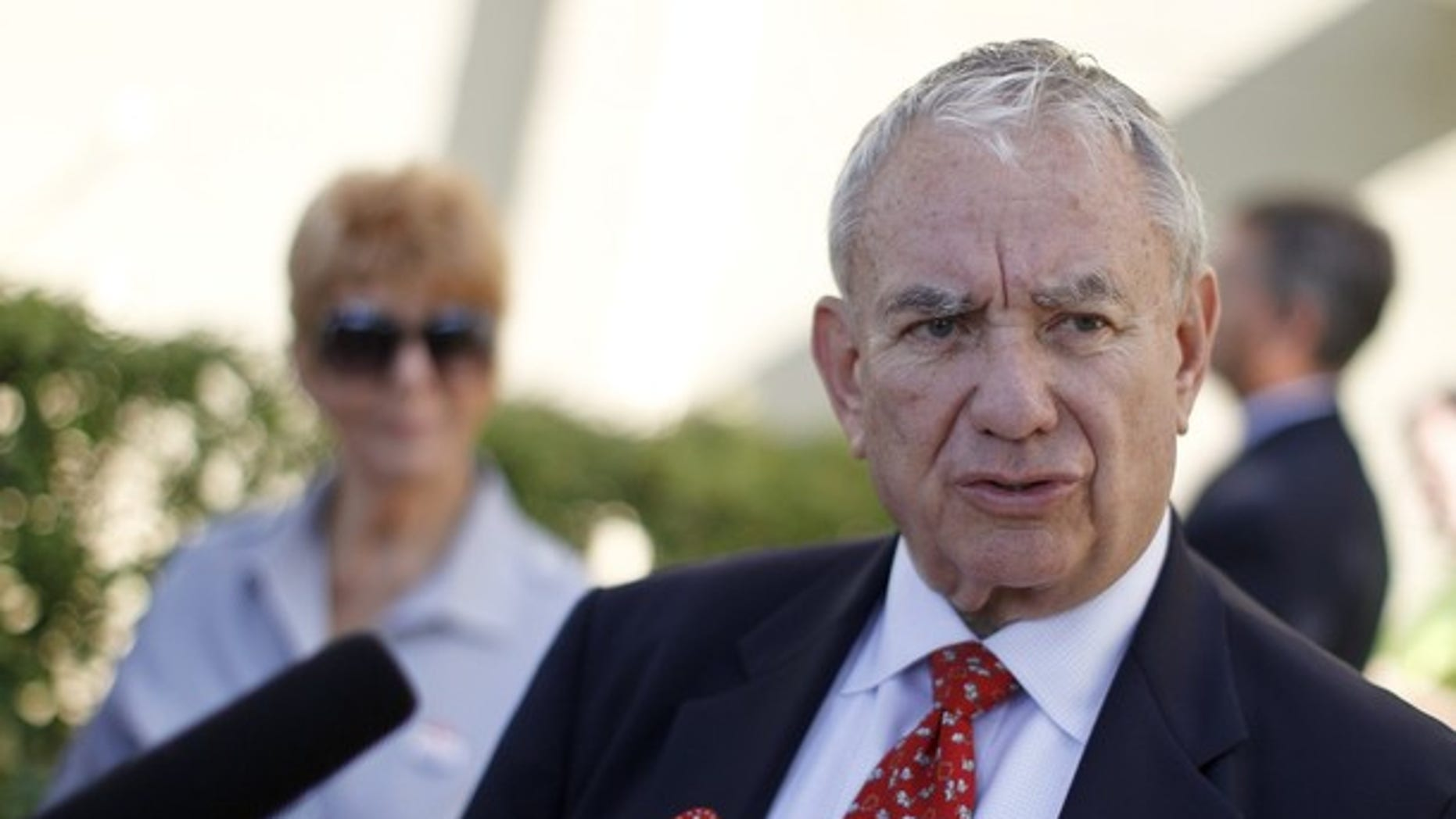 Aug. 14, 2012: Former Wisconsin Gov. Tommy Thompson talks to the media after voting in a primary election.