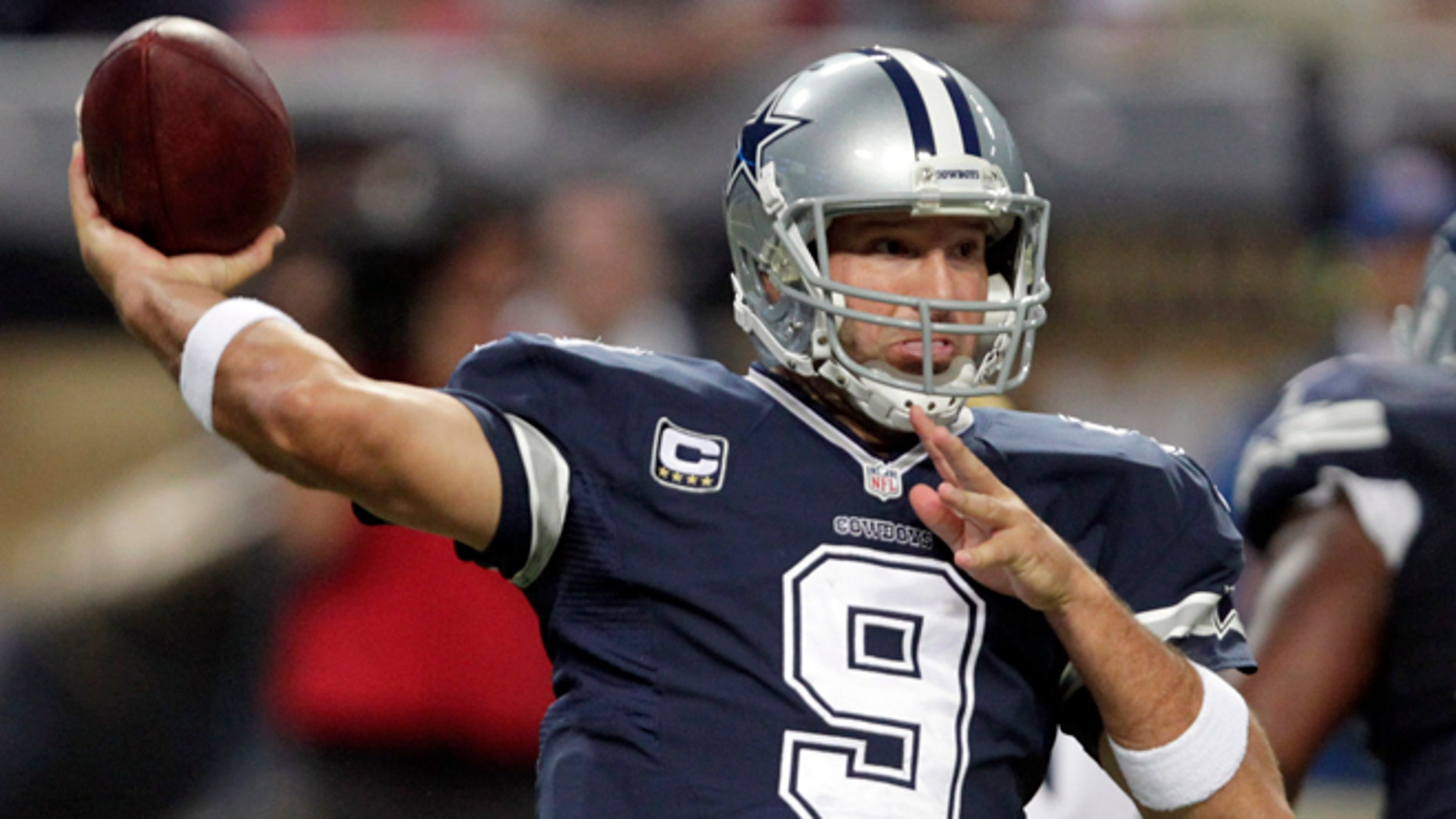 Dallas Cowboys quarterback Tony Romo throws during the second quarter of an NFL football game against the St. Louis Rams, Sunday, Sept. 21, 2014, in St. Louis. (AP Photo/Tom Gannam)