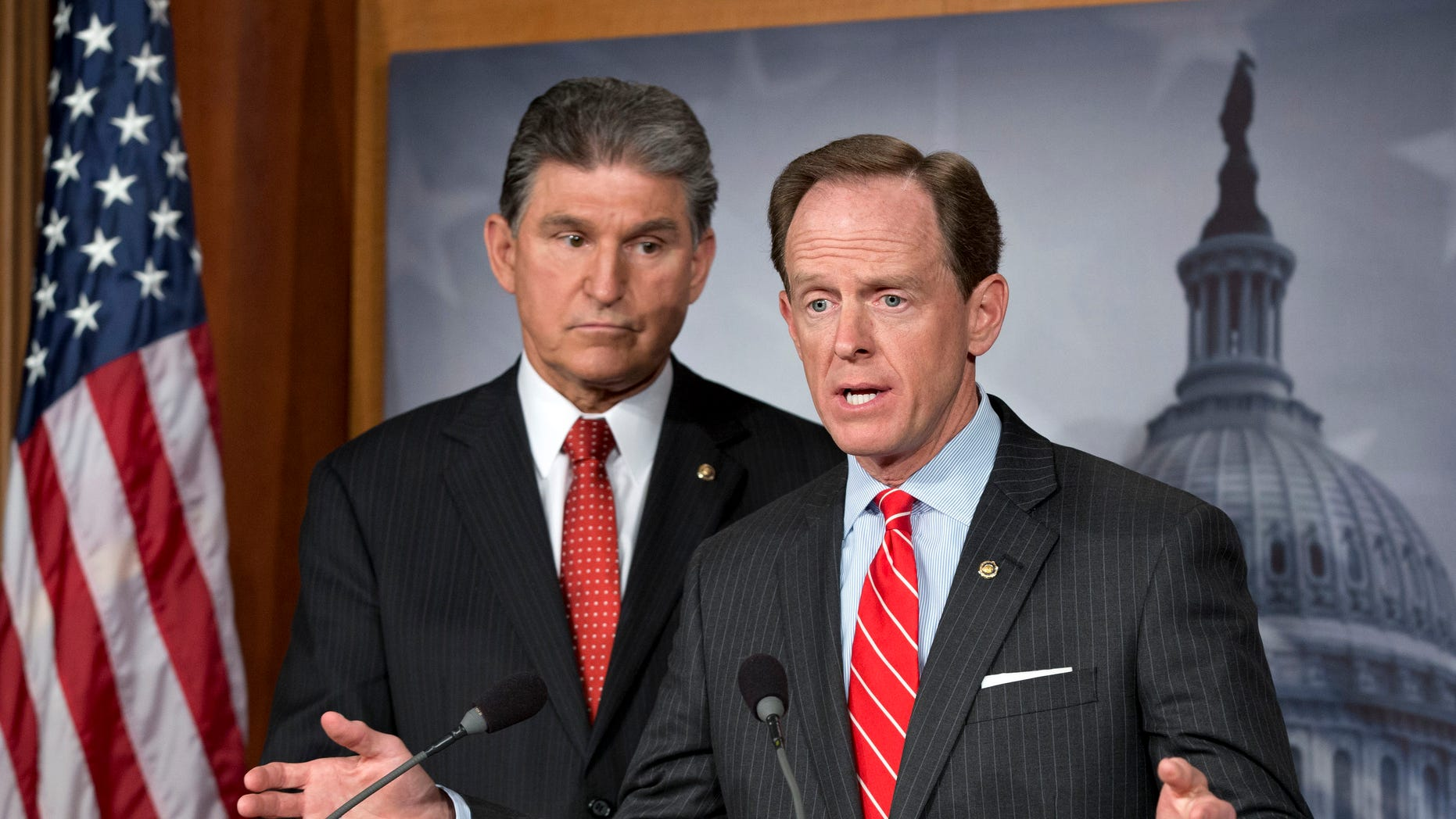 FILE: April 10, 2013: Sen. Joe Manchin, D-W.V., left, and Patrick Toomey, R-Pa., announce a deal on gun-control legislation, on Capitol Hill, in Washington, D.C.
