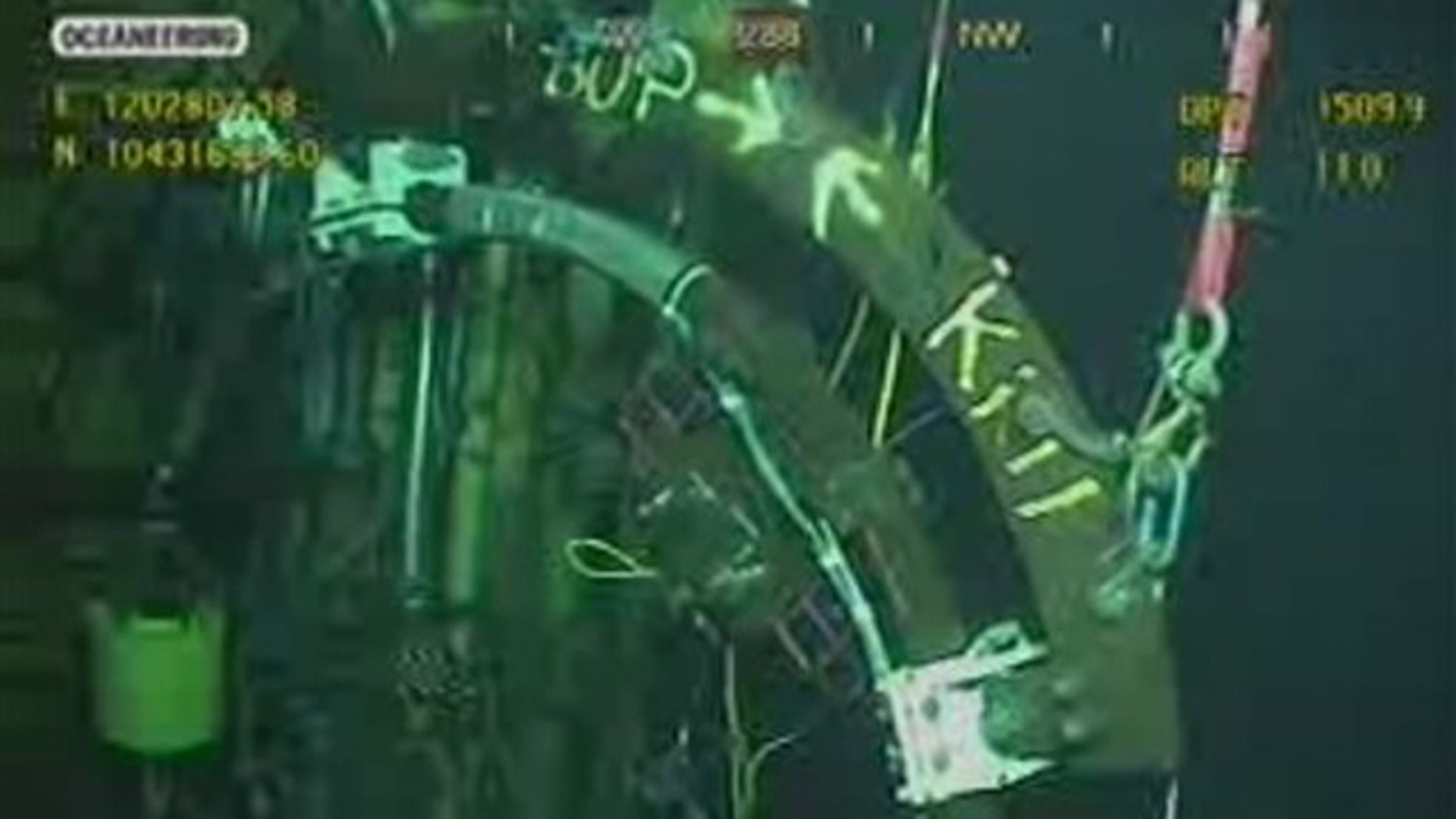 """In this May 26, 2010 photo, officials effort to plug the gushing oil well using a maneuver known as a """"top kill"""" that has never before been tried 5,000 feet underwater."""
