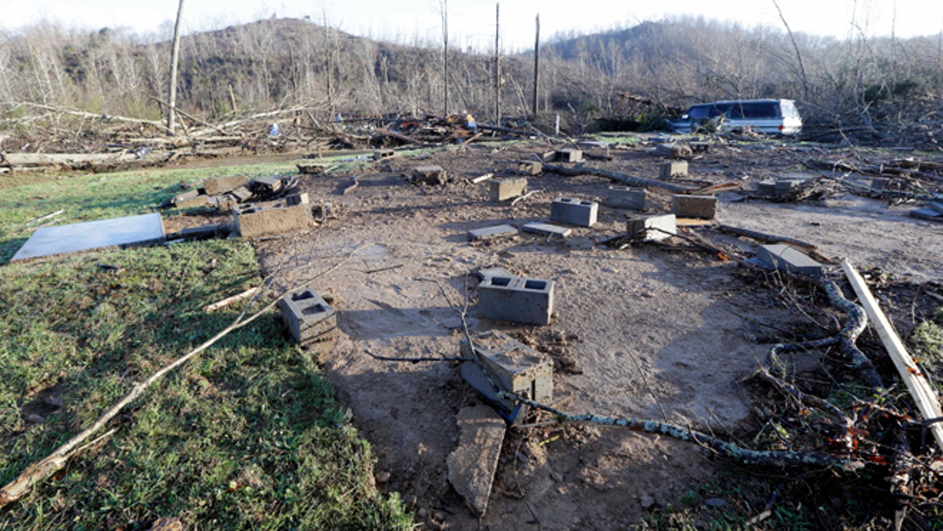 Concrete blocks from the foundation of the home of Antonio Yzaguirre, and his wife, Ann Yzaguirre, show where the house once stood, Thursday, Dec. 24, 2015, after severe storms went through the area Wednesday night near Linden, Tenn. The couple was killed in the storm. (AP Photo/Mark Humphrey)