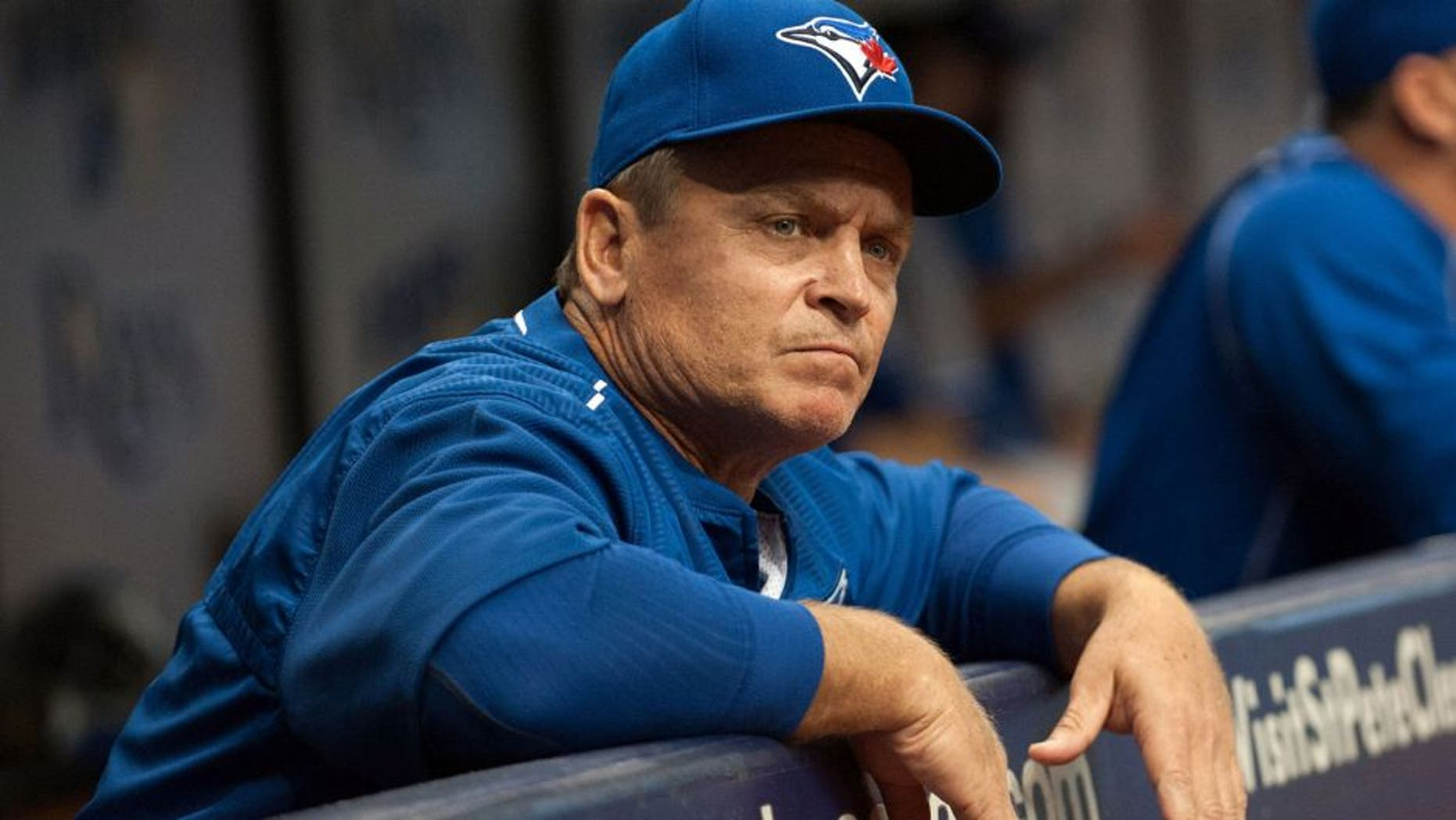 Apr 25, 2015; St. Petersburg, FL, USA; Toronto Blue Jays manager John Gibbons (5) in the dugout during the first inning against the Tampa Bay Rays at Tropicana Field. Mandatory Credit: Jeff Griffith-USA TODAY Sports