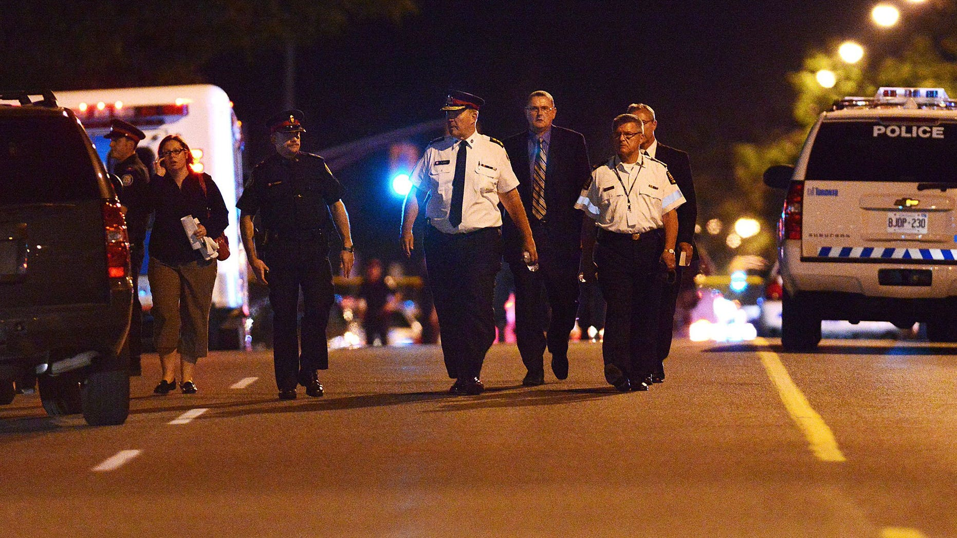 July 17, 2012: Toronto Police Chief Bill Blair walks down Morningside Ave. in Toronto following a shooting that left at least 19 people injured and two dead at a house party.