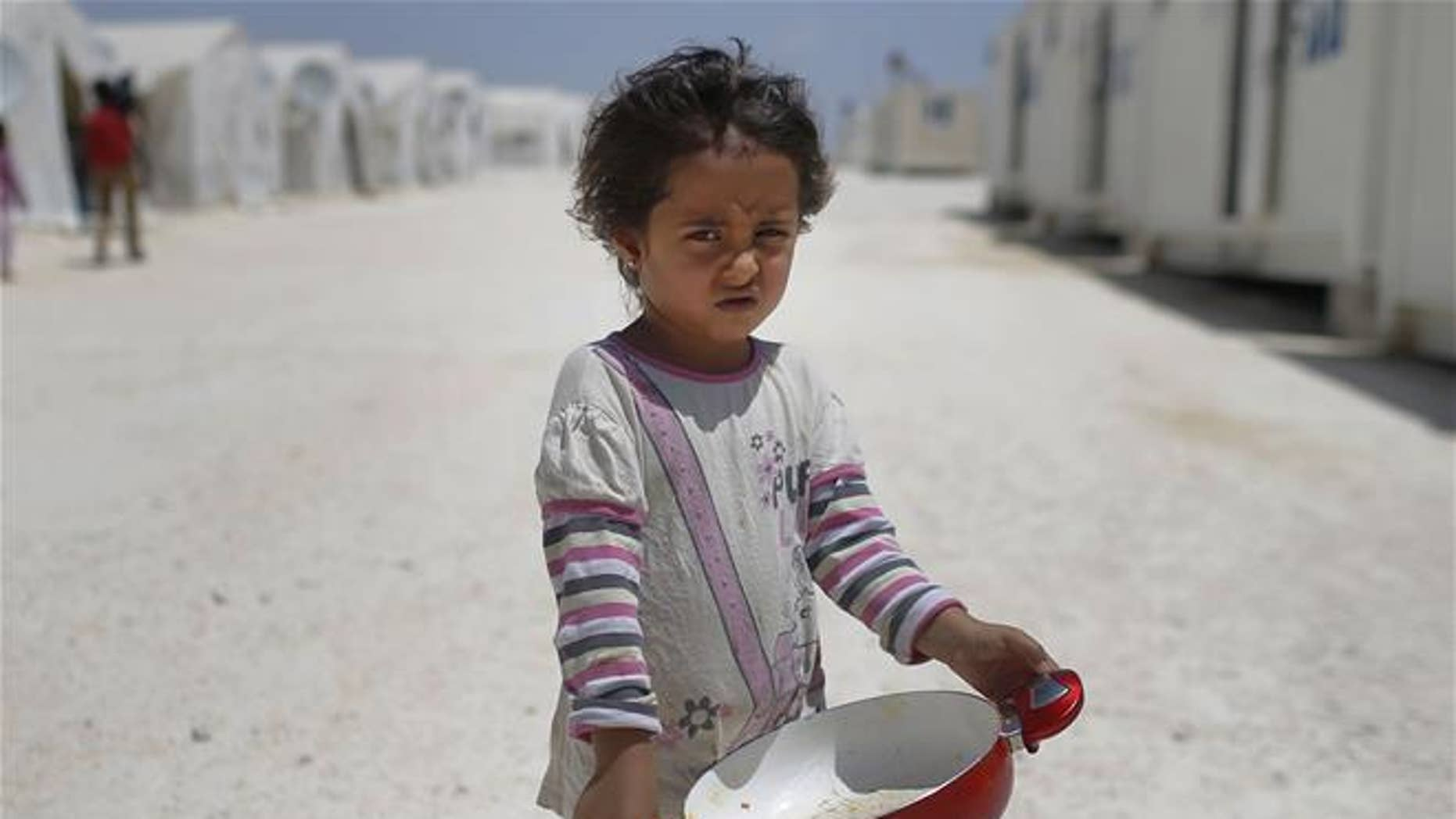 A Syrian refugee child is shown.