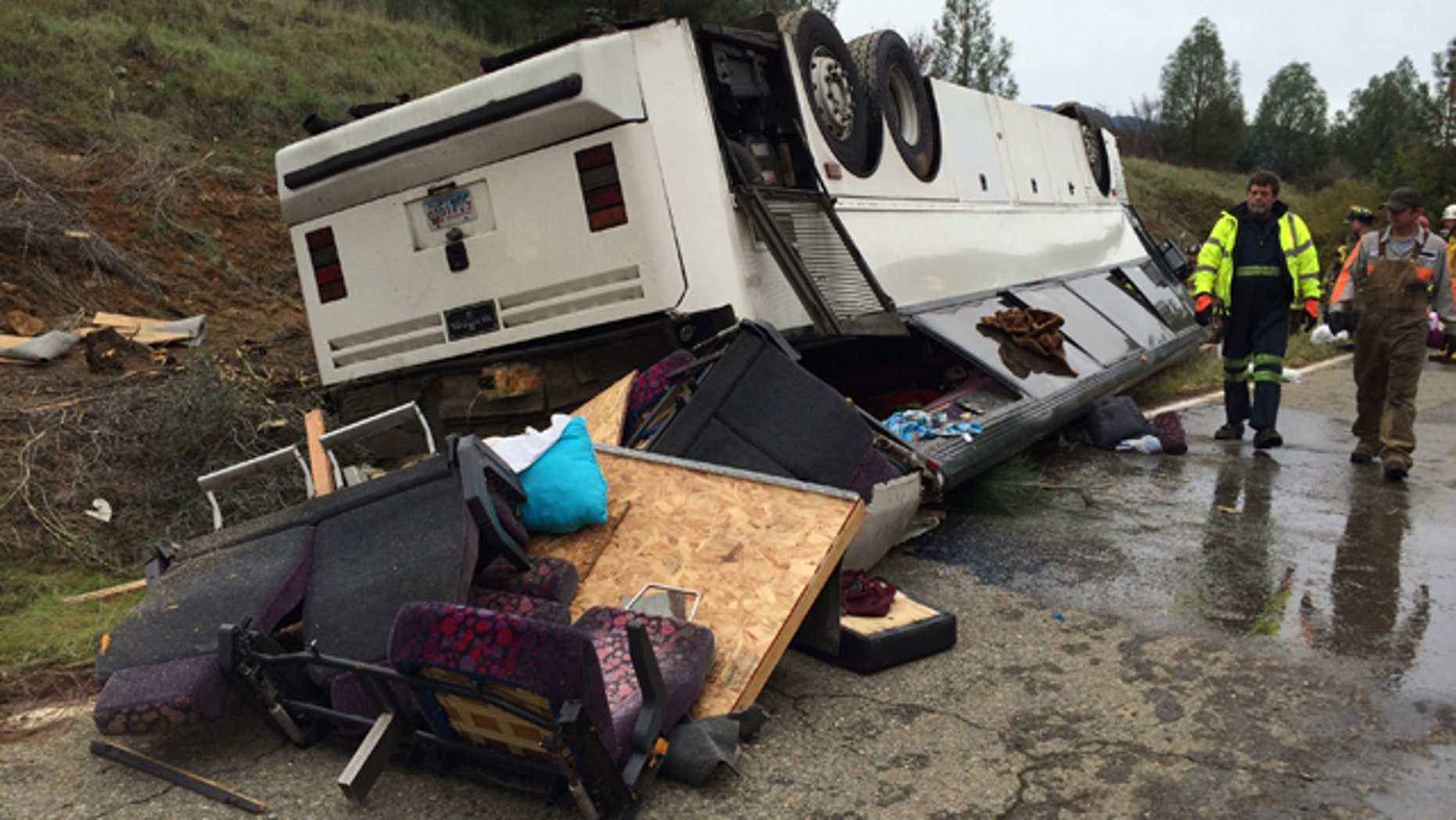 November 23, 2014: Emergency personnel check a tour bus that had already crashed earlier in the day and overturned just off Interstate 5 in Northern California, killing one person and sending dozens to hospitals near the Pollard Flat area in Redding, Calif. (AP Photo/The Record Searchlight, Alayna Shulman)