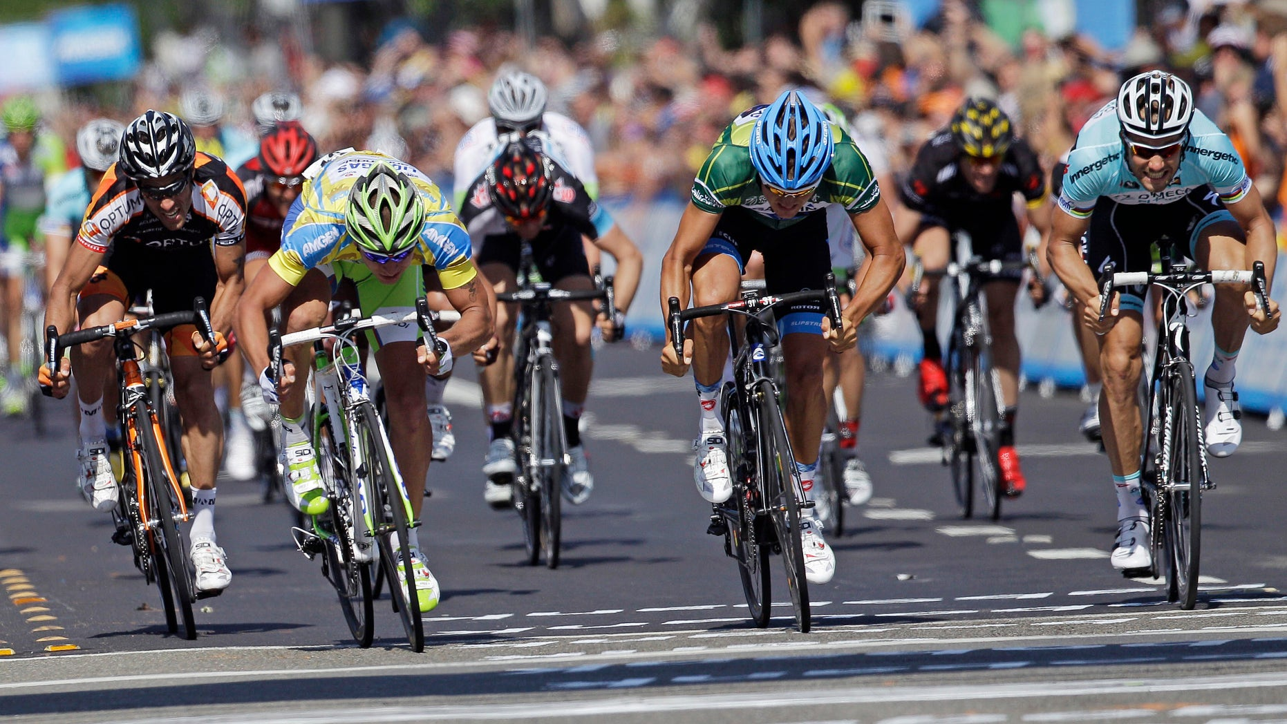 May 15, 2012: From left, Alexander Calendario; Peter Sagan, of Slovakia; Heinrich Haussler, of Australia; and Tom Boonen, of Belgium, sprint to the finish during Stage 3 of the Tour of California cycling race in Livermore, Calif.