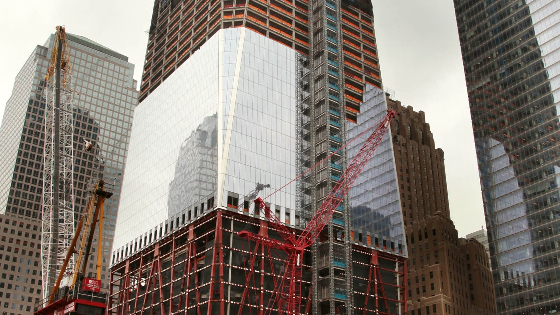 Image of construction on Tower 1 in downtown Manhattan. 7 World Trade Center is on the right.