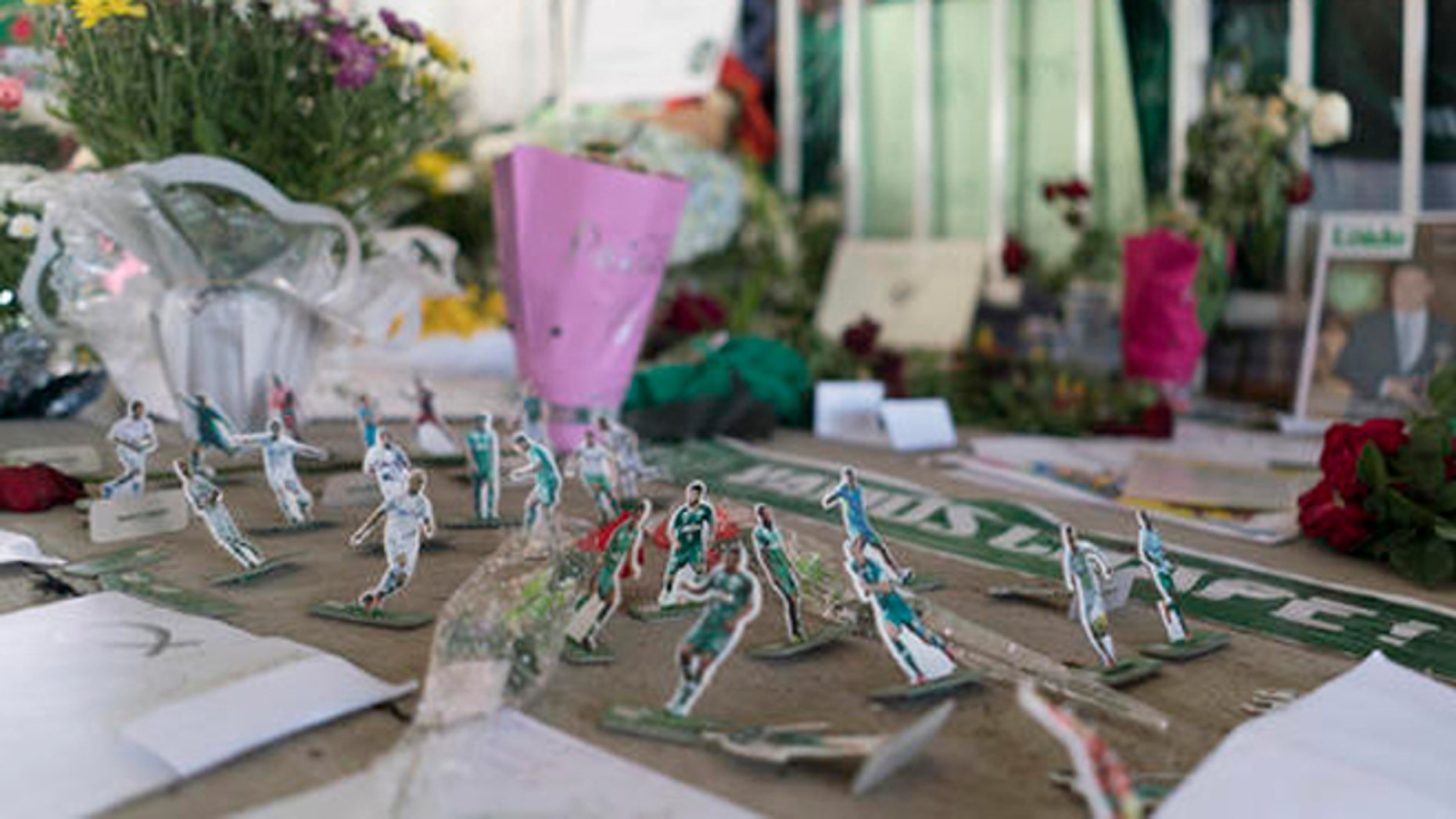 Miniature paper figures of Chapecoense soccer players adorn a makeshift memorial at the clubs stadium Conda Arena in Chapeco, Brazil, Friday, Dec. 2, 2016. The bodies of the Brazilian victims will be repatriated later Friday on three flights to Chapeco, the hometown of the Chapecoense Brazilian soccer team. Members of the team and a group of journalists who perished on the flight were headed to the Copa Sudamericana finals when the plane ran out of fuel, crashing into the Andes outside Medellin.  (AP Photo/Renata Brito)