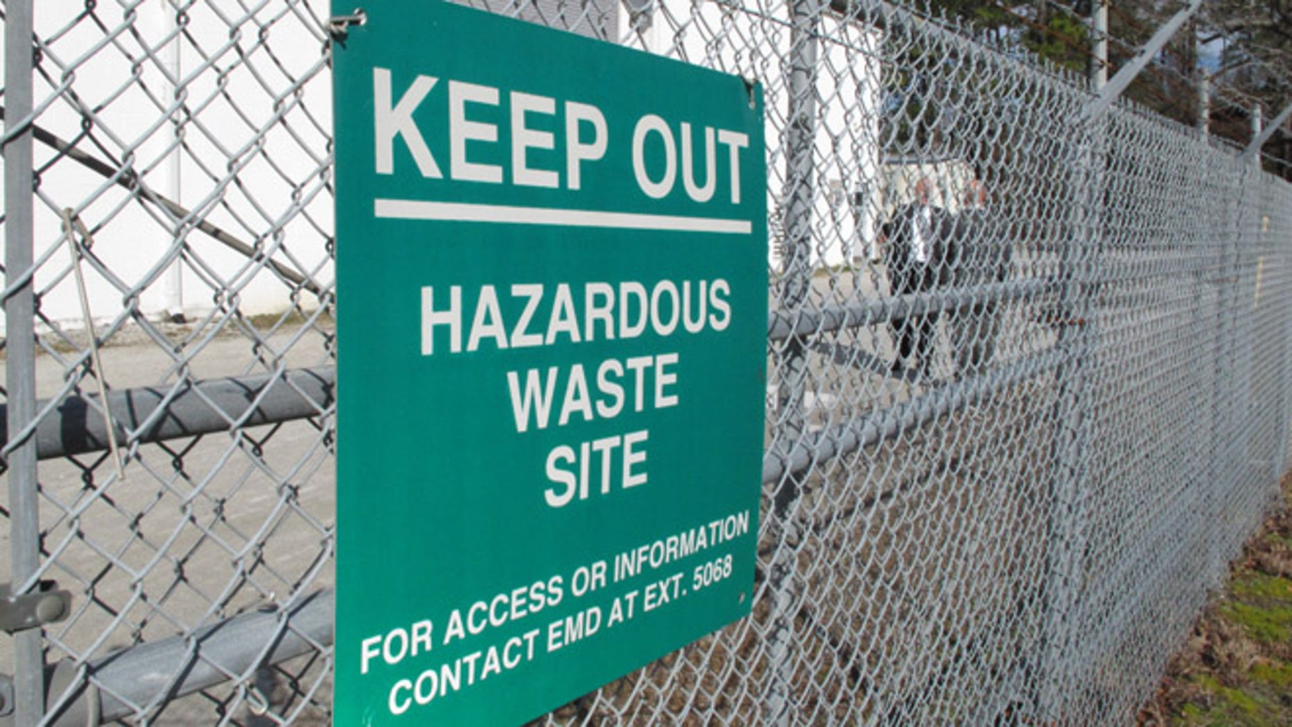 """A sign cautions visitors outside a """"pump and treat"""" facility on the Marine base at Camp Lejeune, N.C., on Wednesday, Feb. 27, 2013. The sprawling installation is the site of one of the worst drinking water contaminations in U.S. history."""