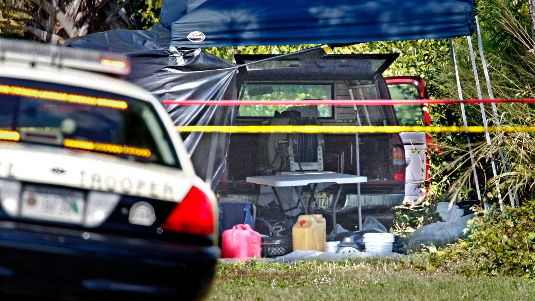 Feb. 16: Authorities investigate Jorge Barahona's pesticide truck after it was found Feb. 14 along the side of Interstate 95 near West Palm Beach, Fla. The badly deteriorated body of Barahona's 10-year-old daughter was discovered in the truck hours after her critically injured twin brother was found having seizures in the front seat, doused in acid by his father, according to officials.