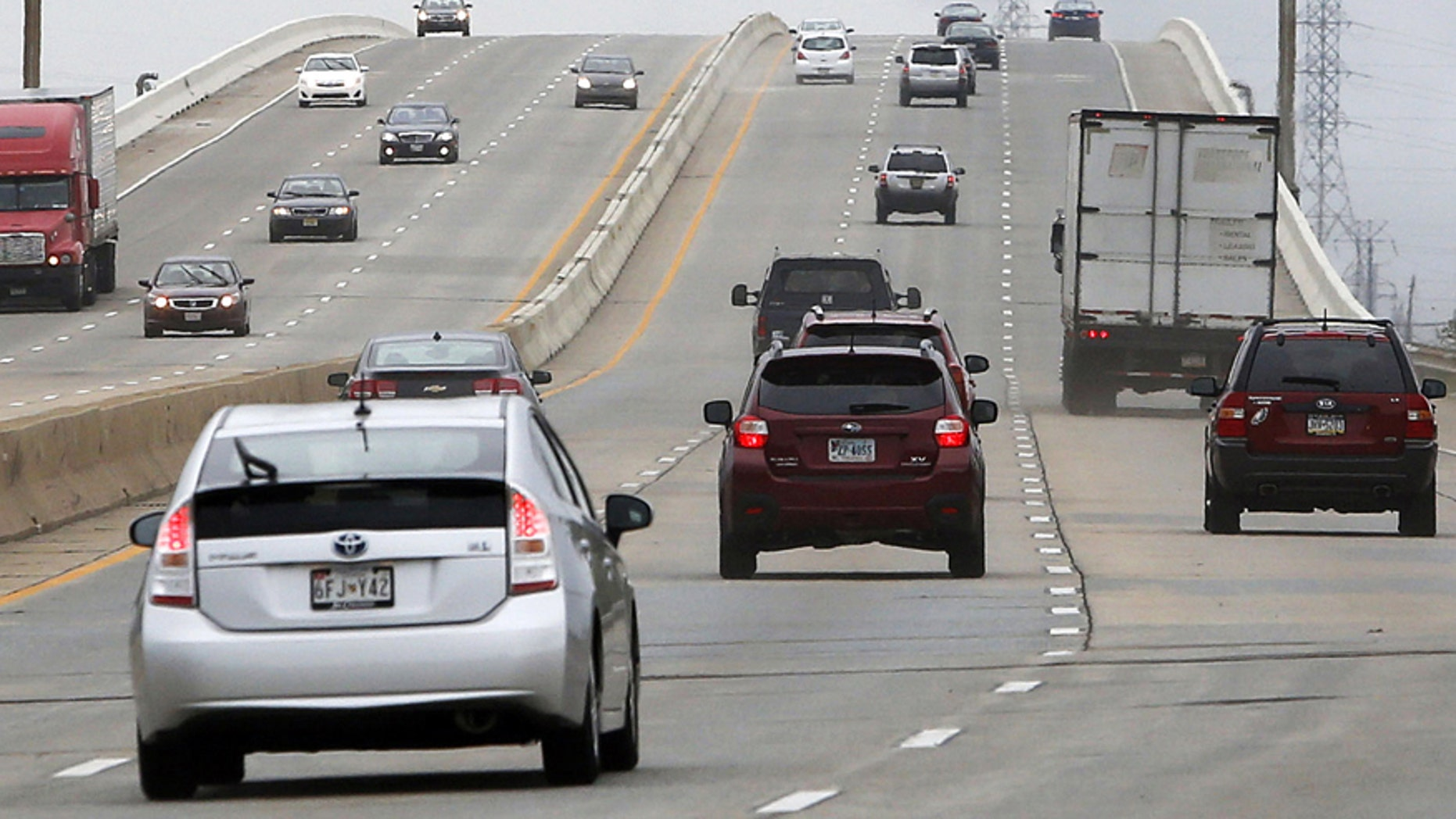 Traffic flows along the northbound lanes of Interstate 495 over the Christina River, Saturday afternoon, Aug. 23, 2014, after Delaware transportation officials reopened the highway after completing repairs to the bridge. The bridge was closed in early June because several supporting columns were tilting. (AP Photo/The Wilmington News-Journal, William Bretzger)