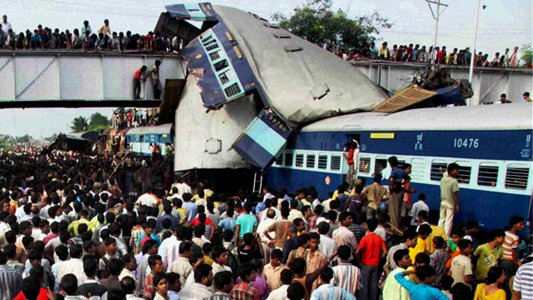 July 19: A speeding express train collided with a passenger train at the Sainthia station in eastern India early Monday, mangling the carriages and killing scores of people, railway police said. (AP)