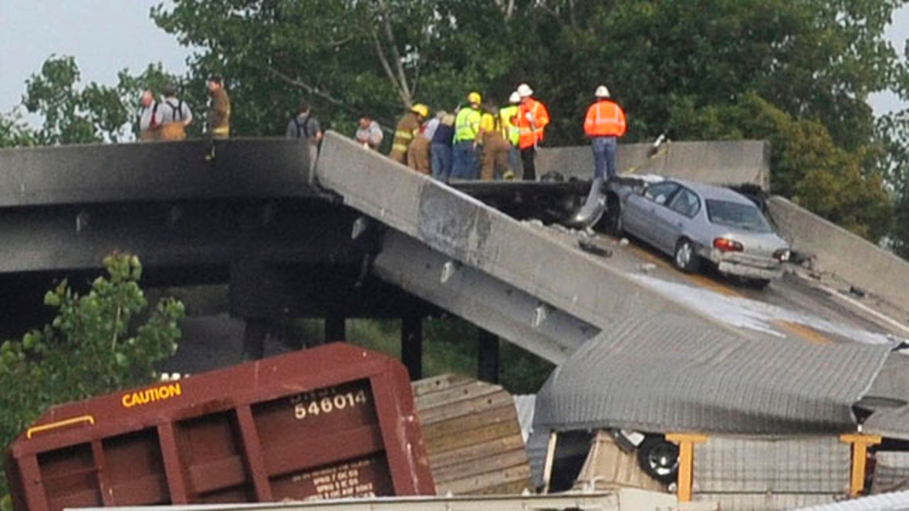 May 25, 2013: Emergency personnel respond to the scene of a train derailment near Rockview, Mo.